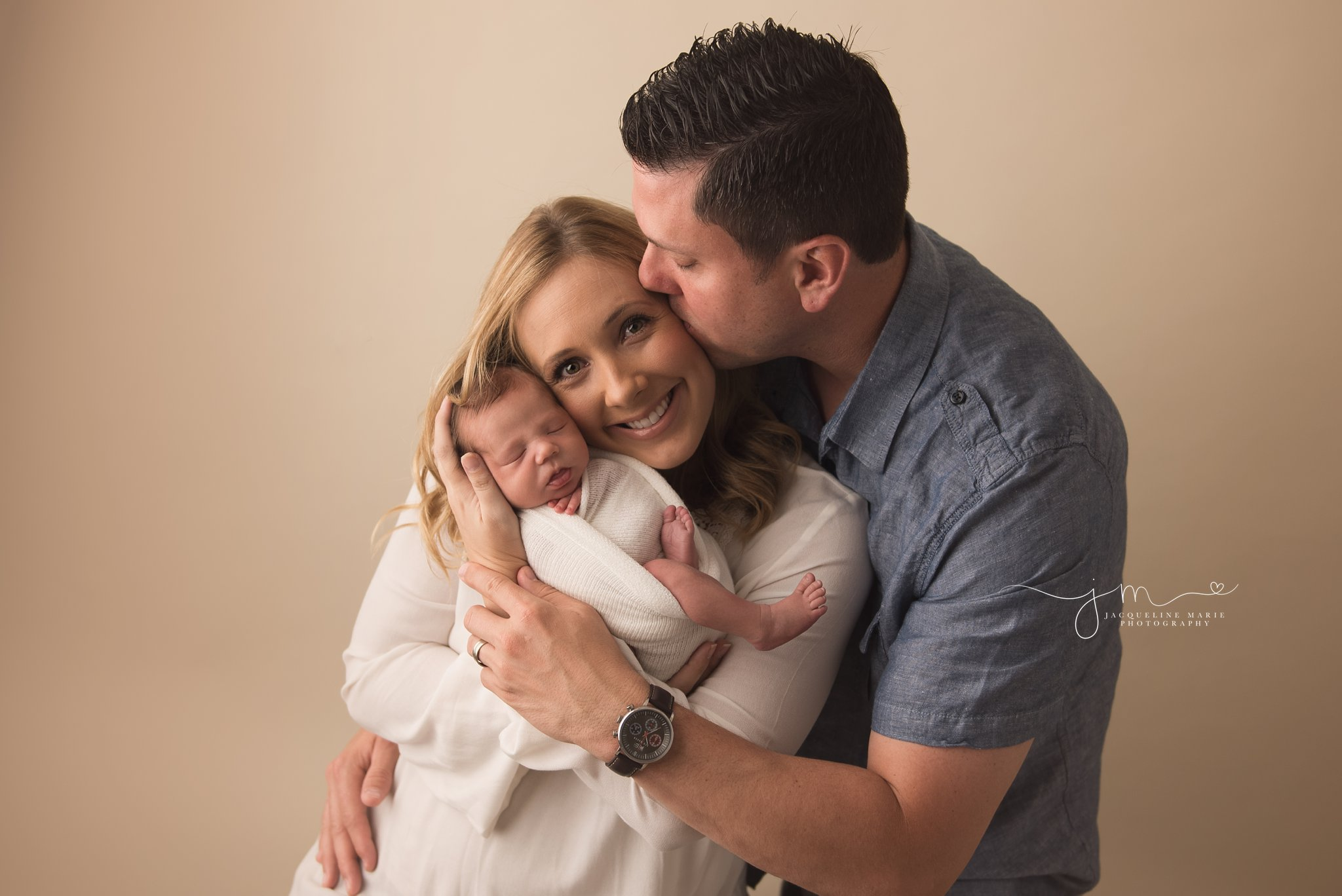 mother holds newborn baby boy while father kisses her in columbus ohio