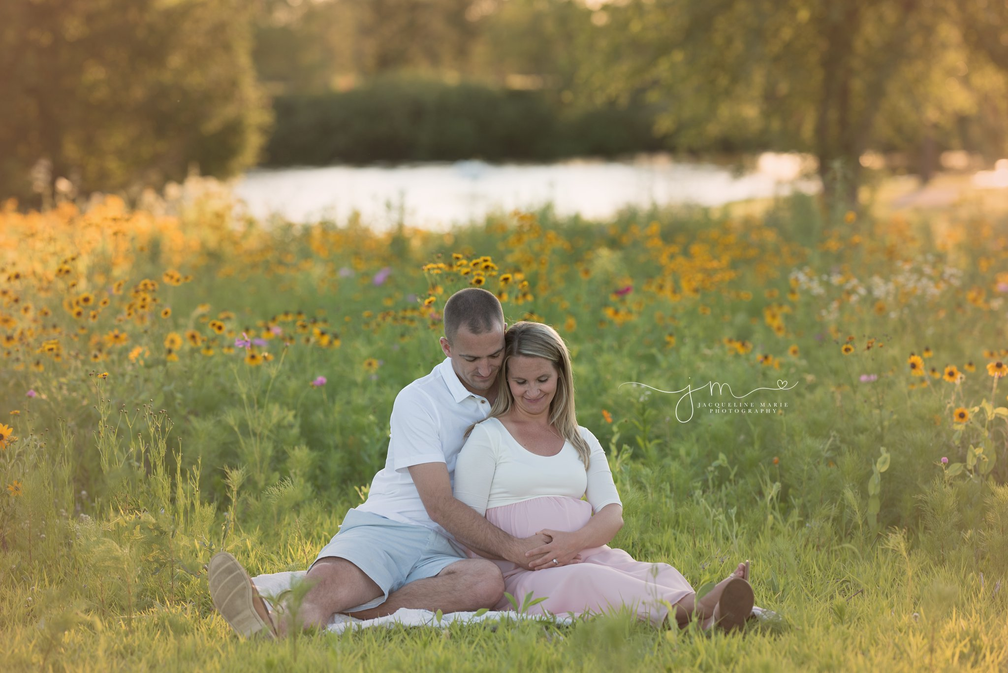 columbus ohio newborn photographer features pregnancy picture of soon to be mother and father smiling at sunset