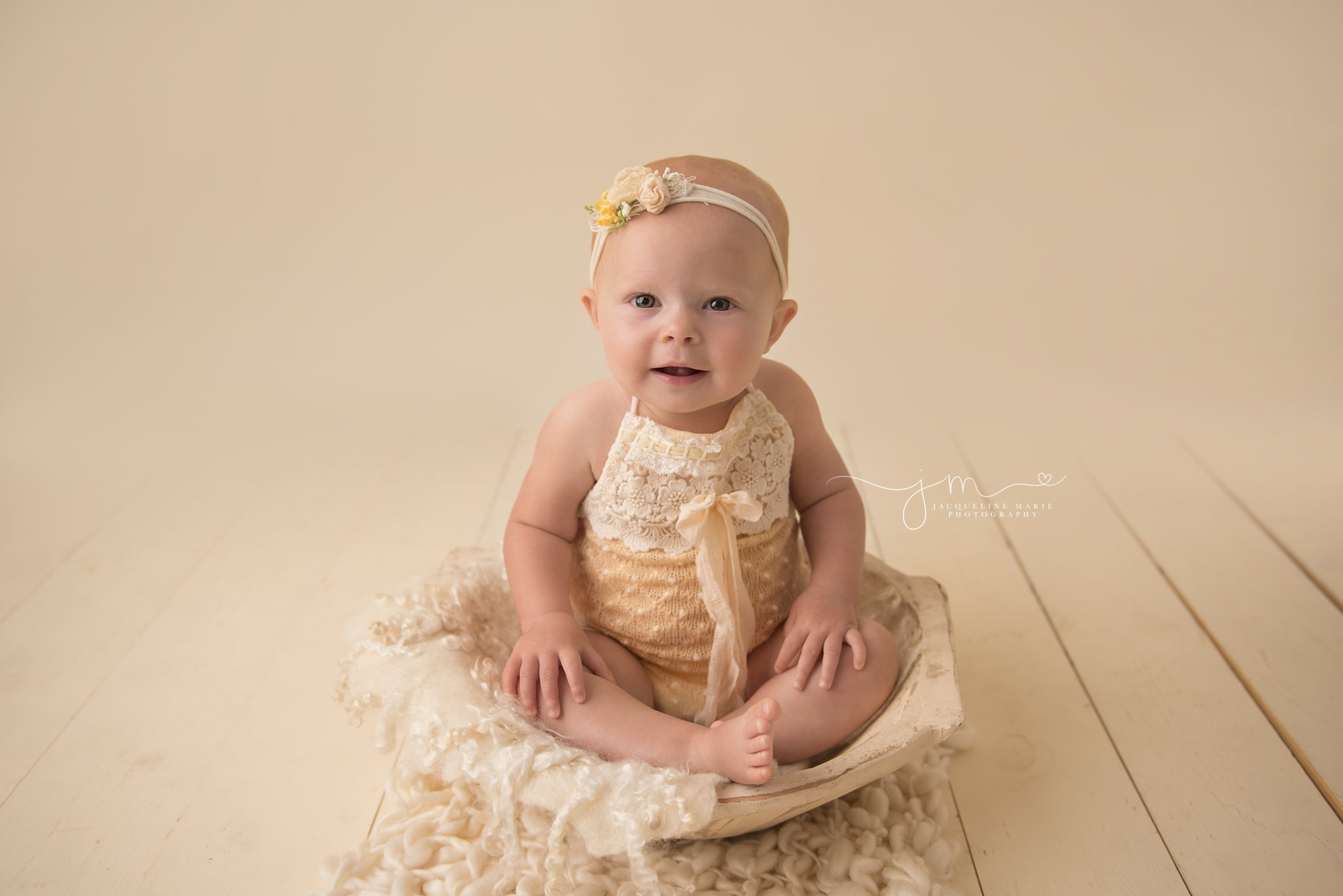 columbus ohio newborn and child photographer features image of baby girl wearing yellow romper
