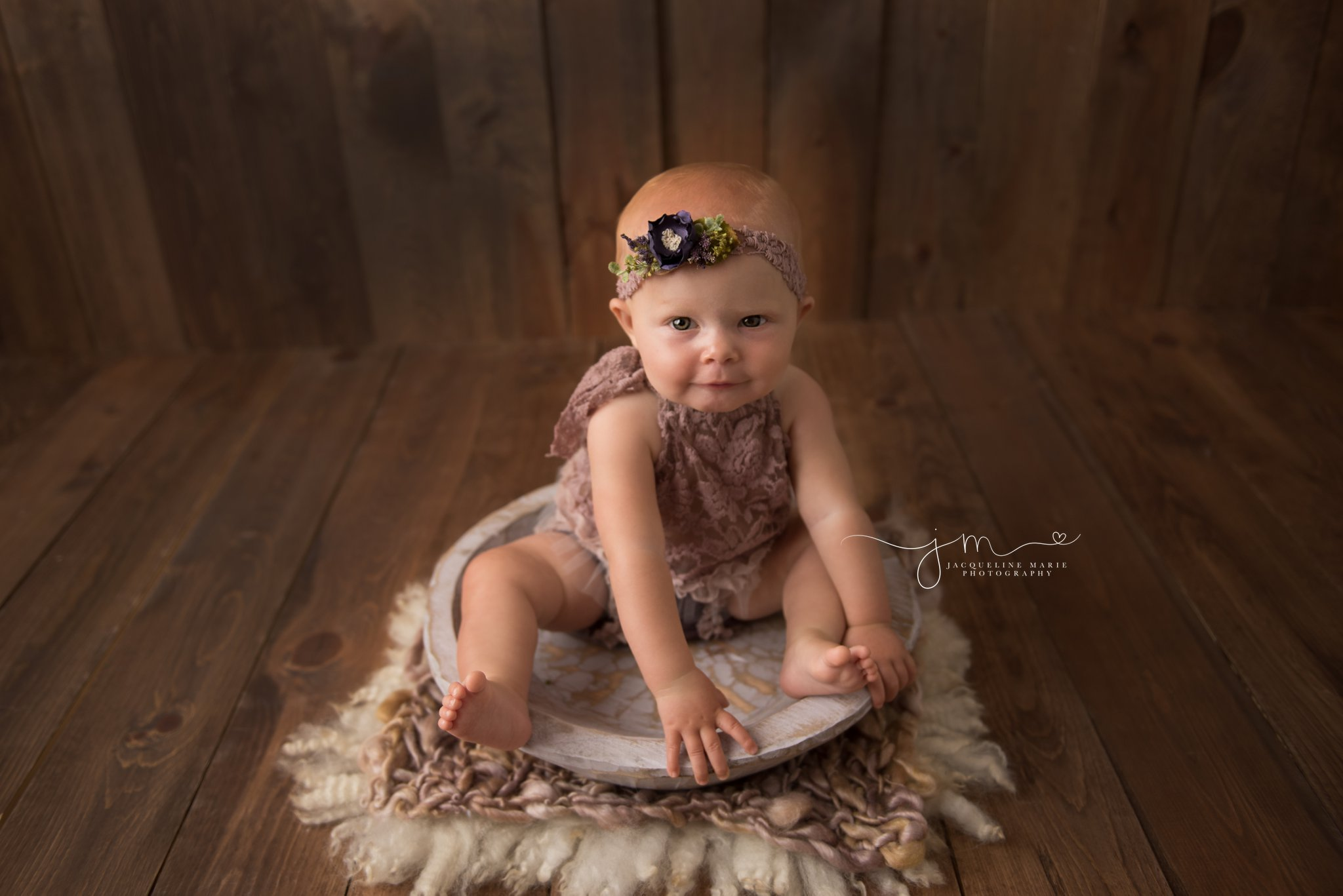 columbus ohio baby photographer features image of 8 month old baby sitting on purple wood bowl