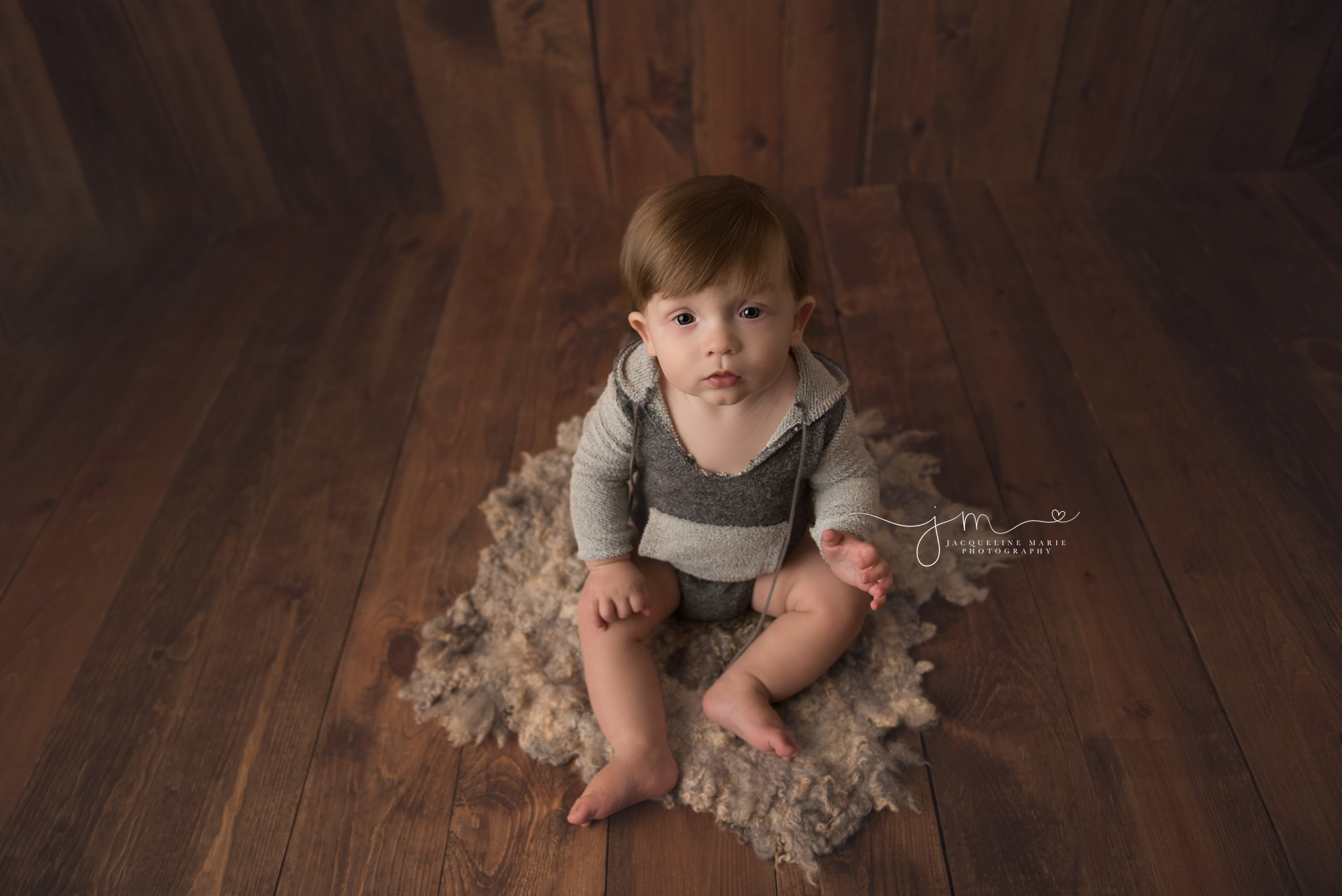 columbus ohio baby photographer features baby boy wearing gray hooded romper for photography session