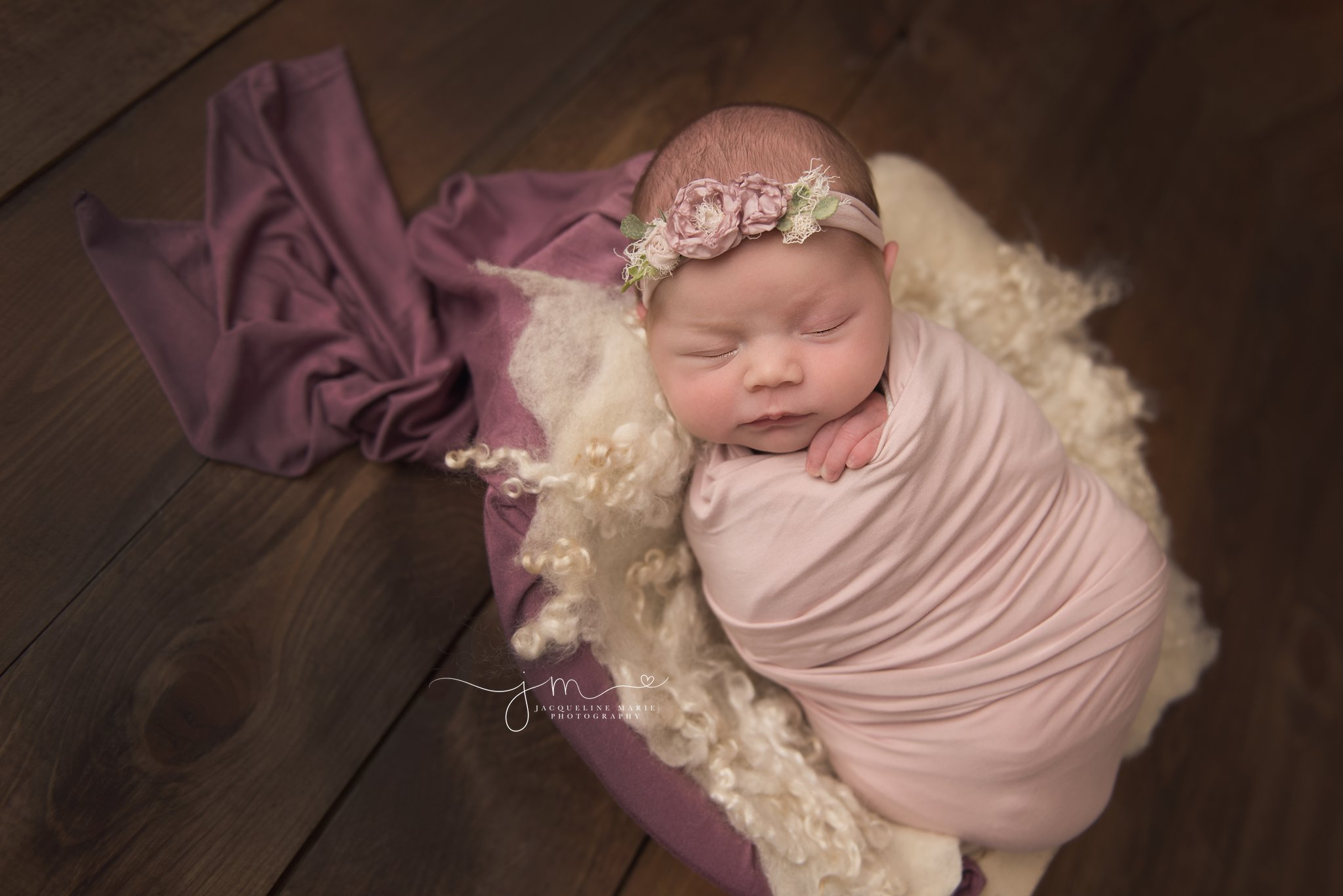 columbus ohio newborn photographer features images of baby girl sleeping is wood bowl