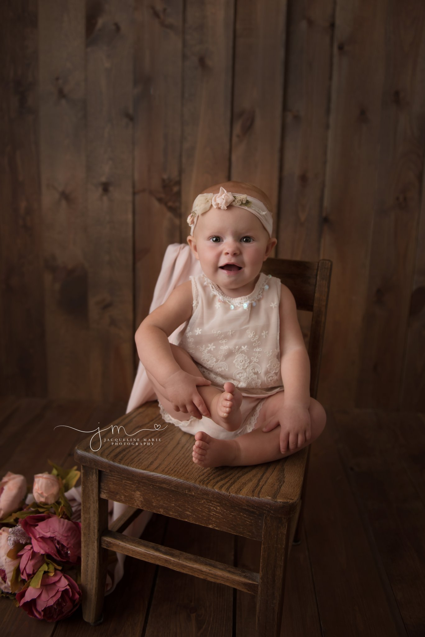 columbus ohio baby photographer features image of baby girl on wood chair