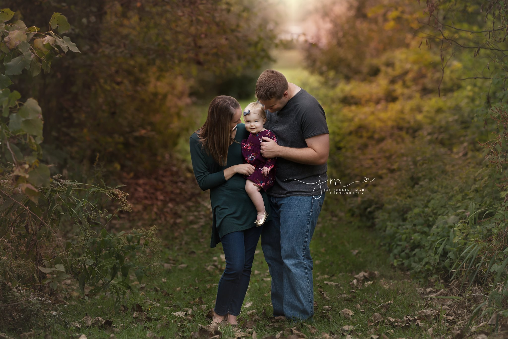 mother and father hold daughter while smiling in columbus ohio
