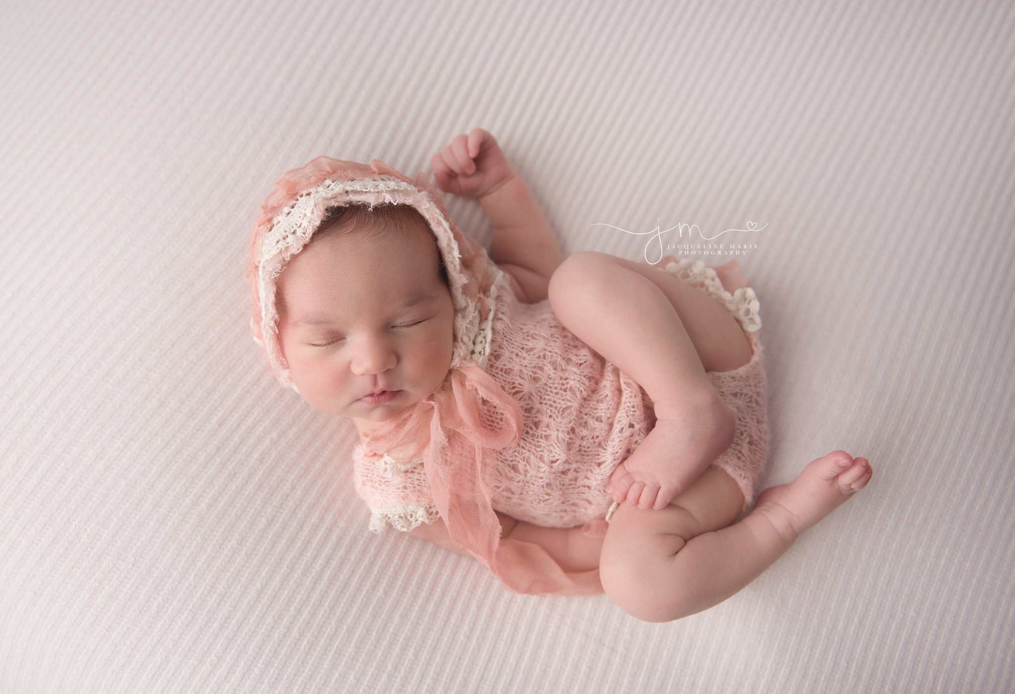 columbus ohio newborn photographer features images of baby girl wearing pink and cream lace bonnet while sleeping