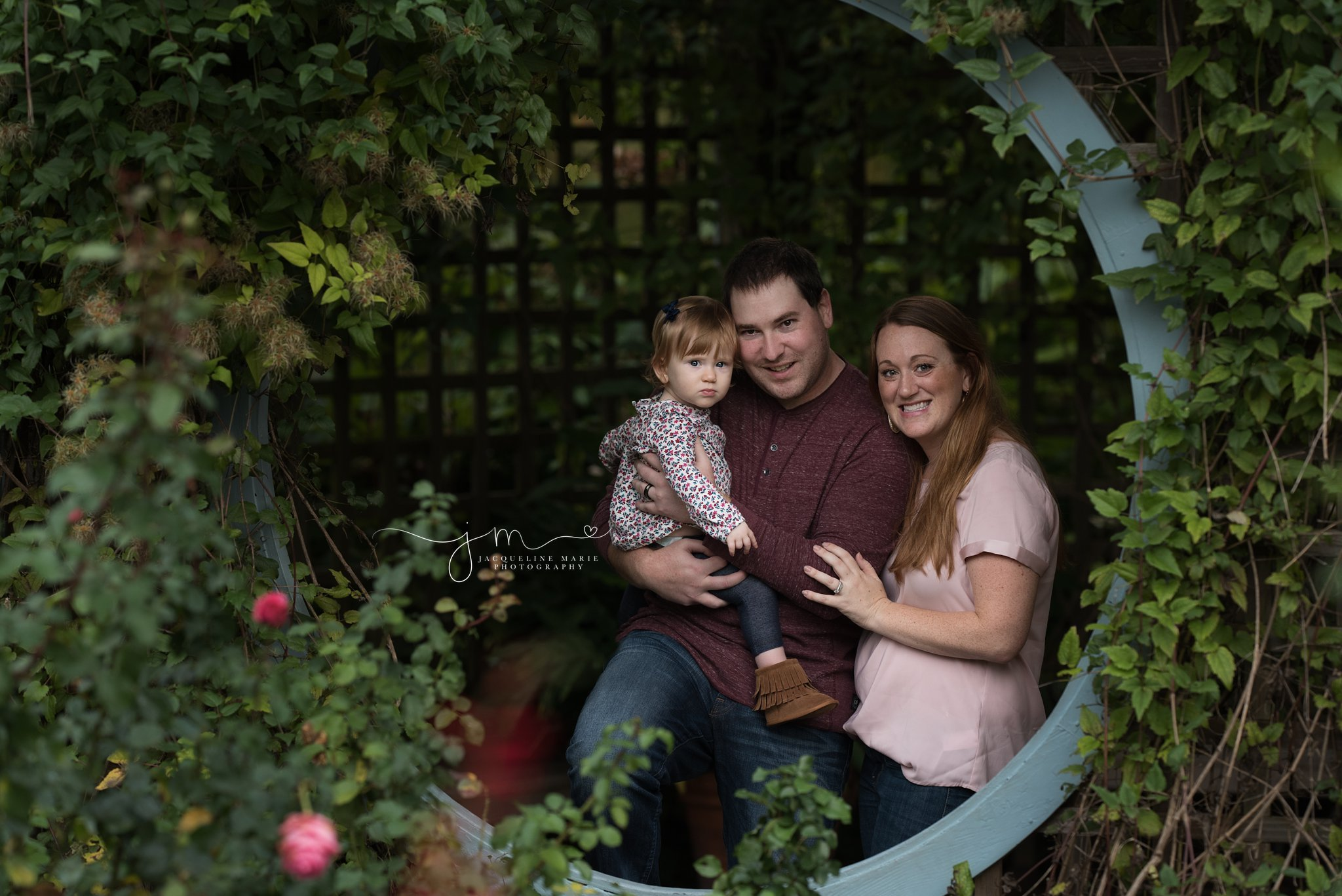 columbus ohio family photographer features image of mother and father holding child for fall family photography