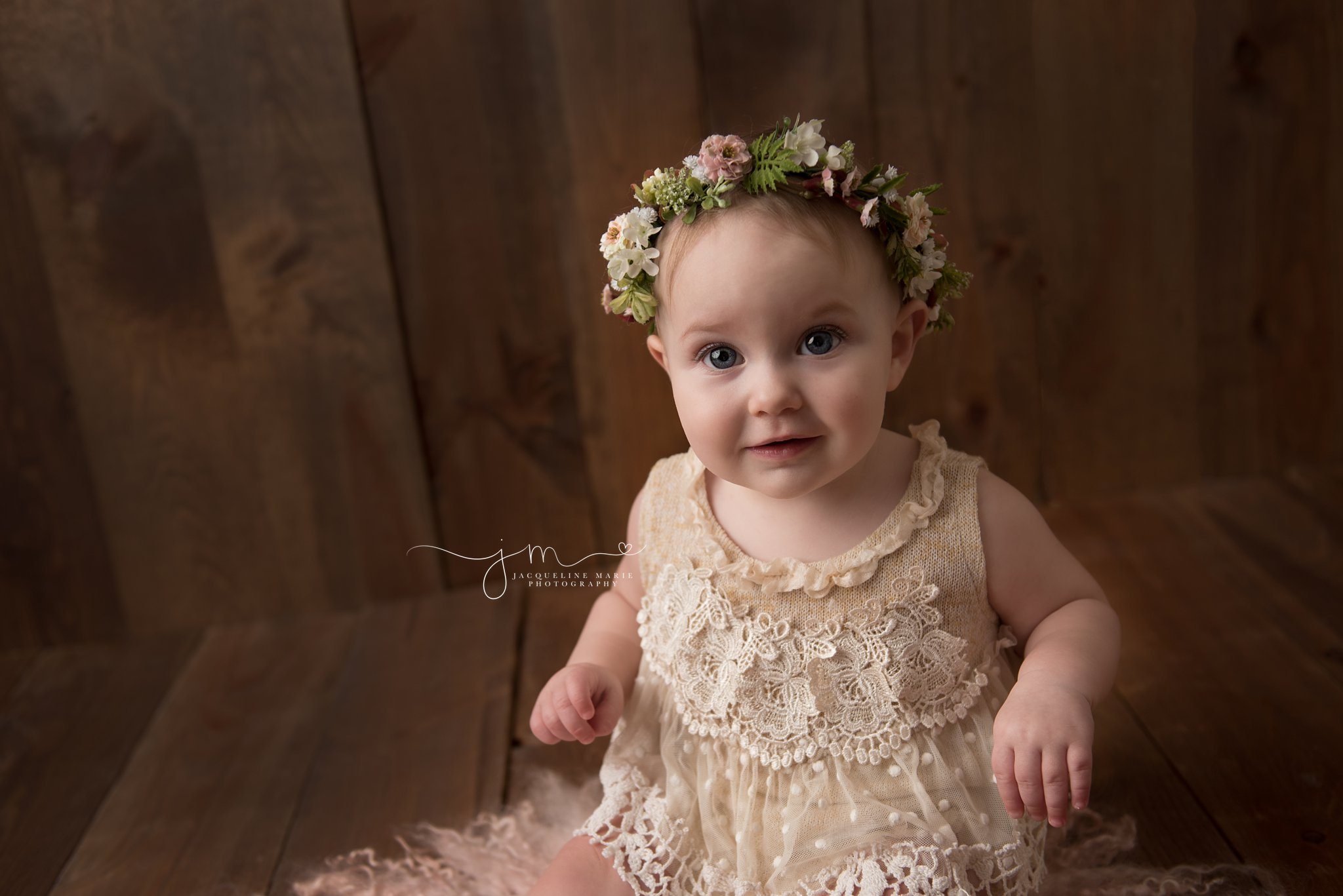 1 year old nora wears a floral crown for first birthday pictures in columbus ohio