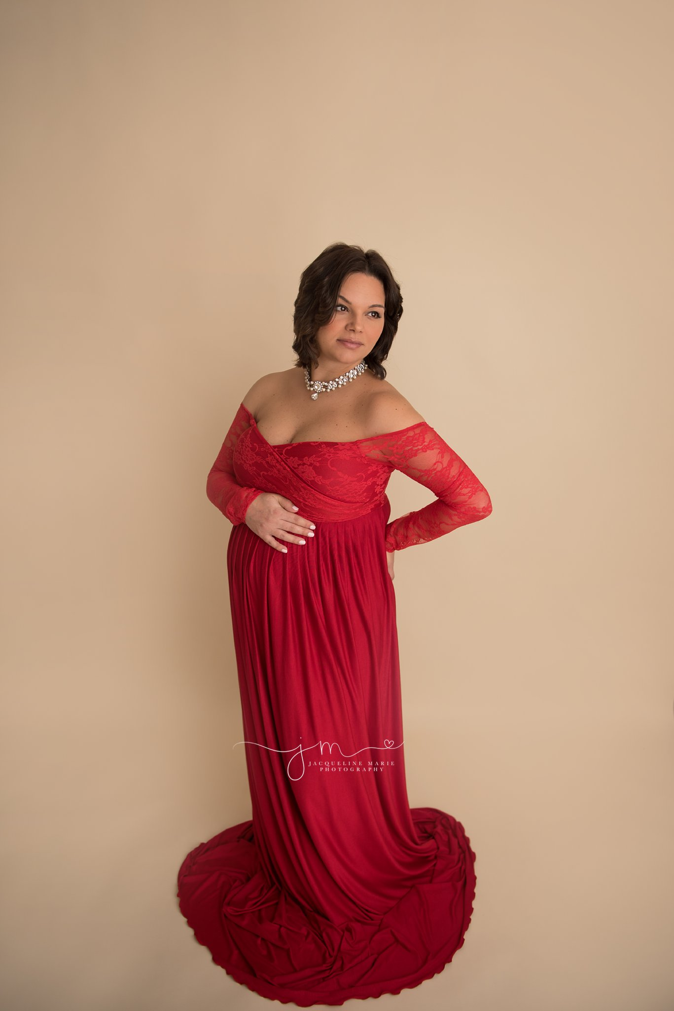 columbus ohio maternity photographer features image of mother to be in red maternity gown