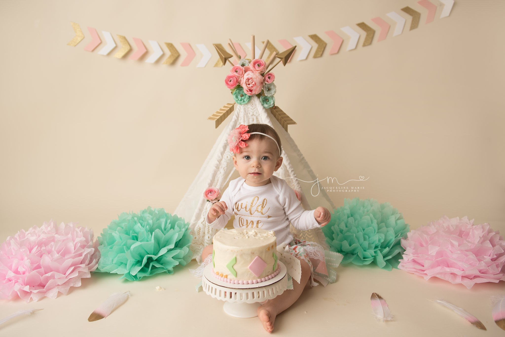 first birthday cake smash session includes cake with arrows in columbus ohio photography studio