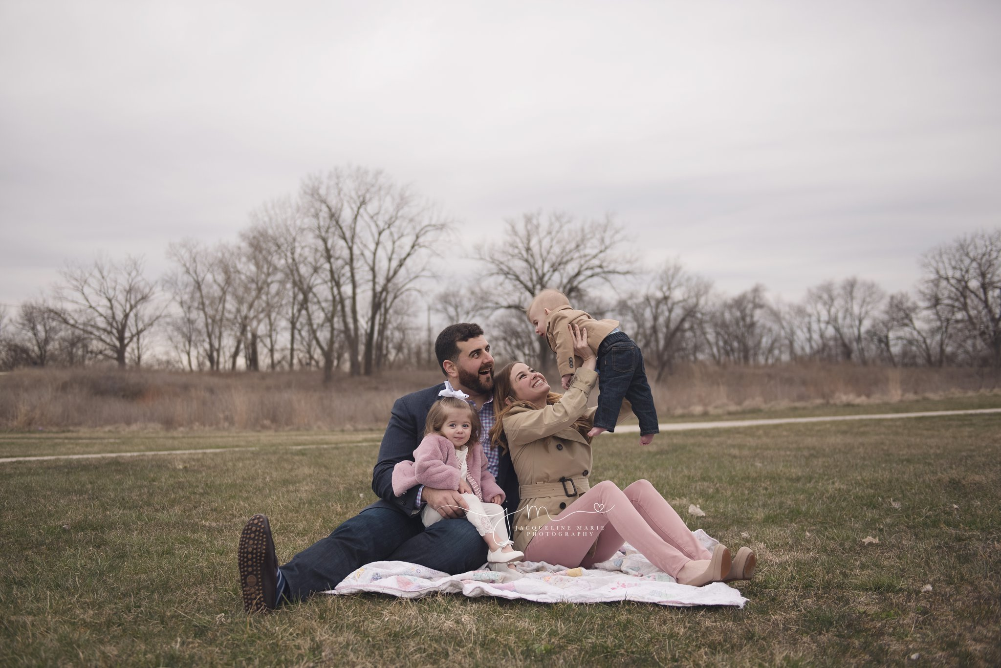 columbus ohio family photographer captures family of four smiling during outdoor family photography session