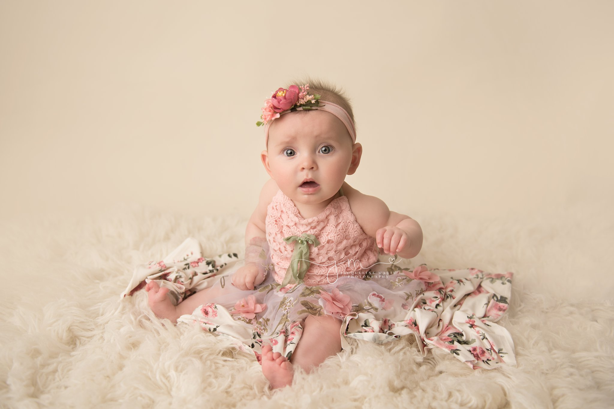 columbus ohio baby photographer features image of 6 month old baby girl in pink floral romper