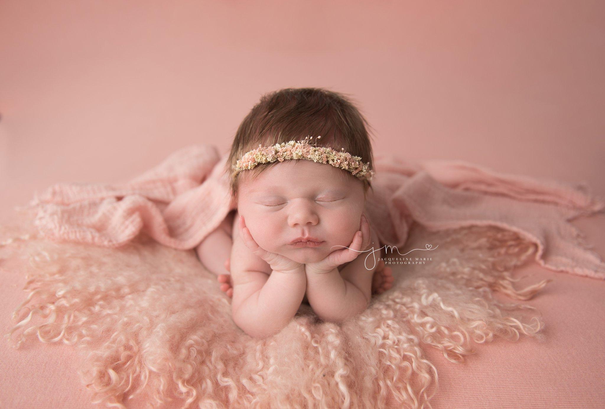 columbus ohio newborn baby girl wears pink floral crown for newborn portraits