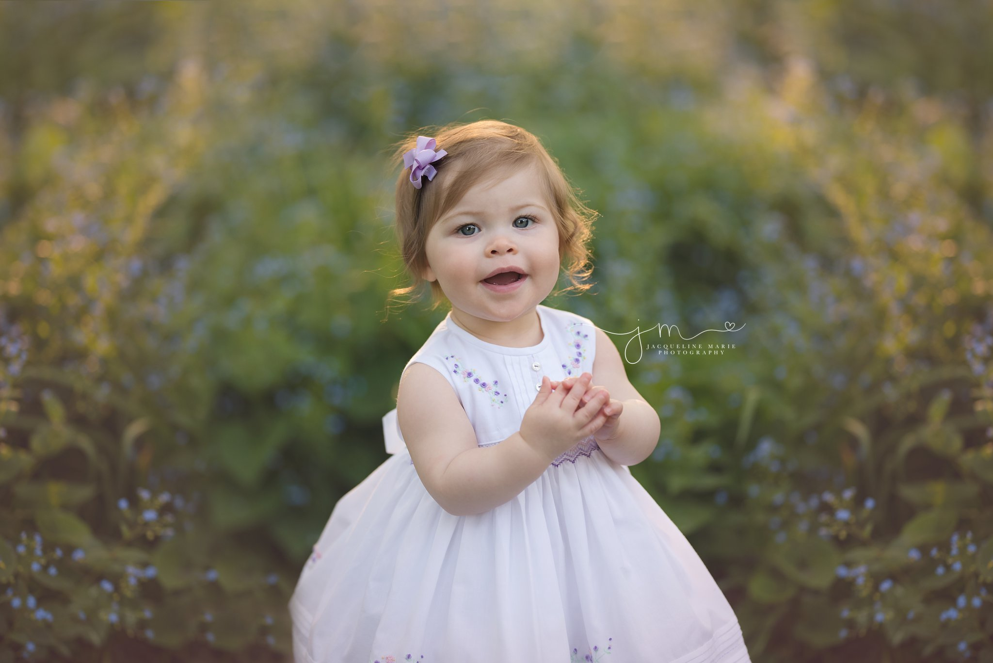 1 year old little girl smiles during mommy and me photography session in columbus ohio