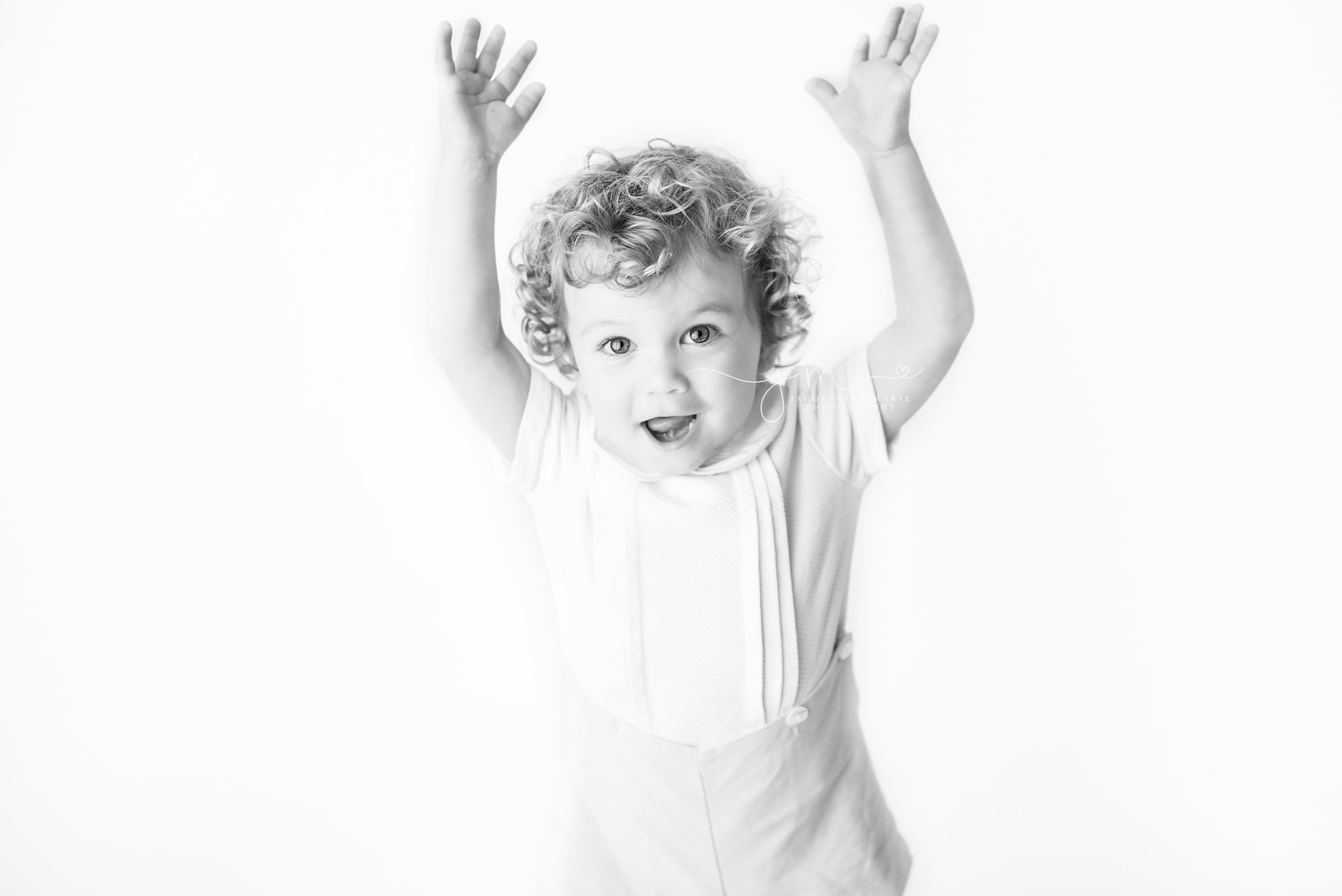 black and white images captures smiles from 2 year old boy in columbus ohio