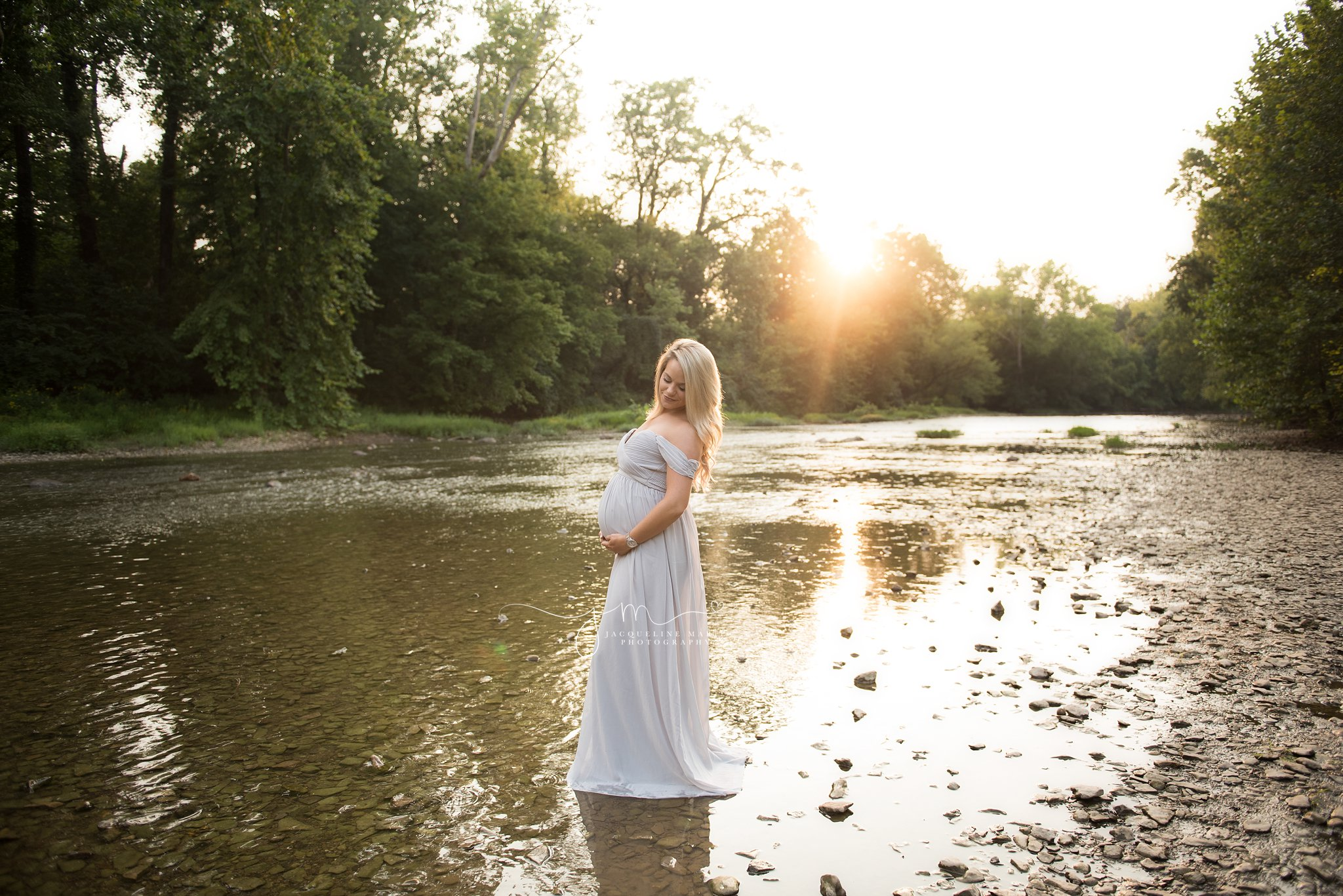 columbus ohio maternity session during golden hour sunset at metro park with water and rocks