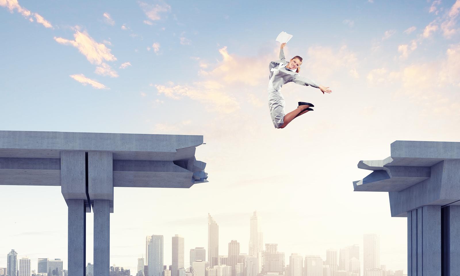 woman jumping hurdle.jpg
