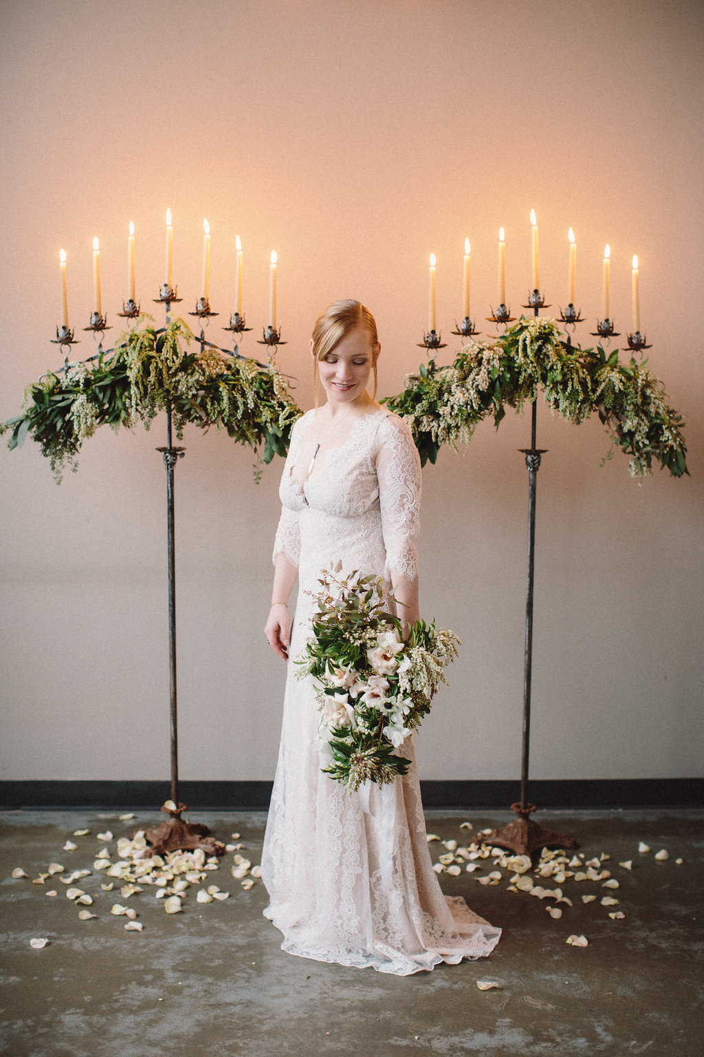 Ceremony flower arrangements by Nectar & Root | Wedding floral design services in Burlington, Vermont (VT) | Candelabras with blush garden roses, pieris japonica, tapered candles