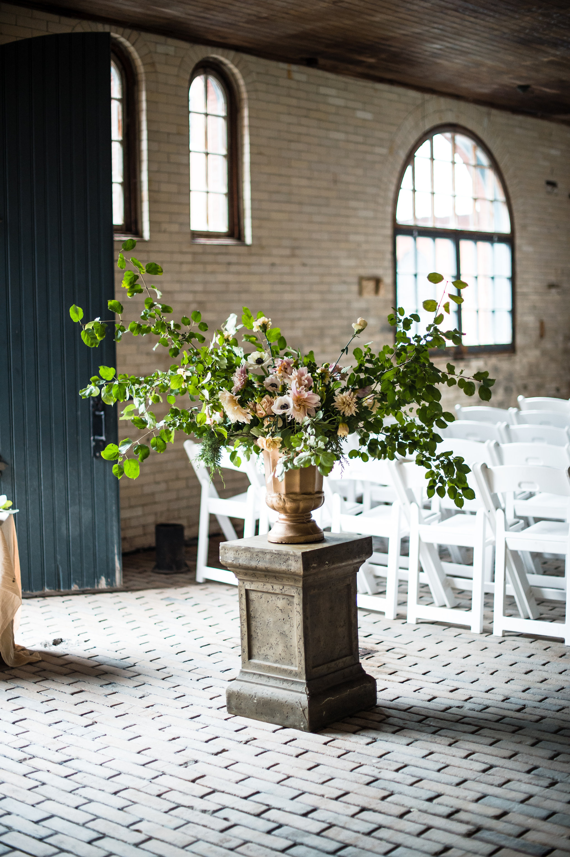 Ceremony flower arrangements by Nectar & Root | Wedding floral design services in Burlington, Vermont (VT) | Urn with dahlias, anemones, garden roses