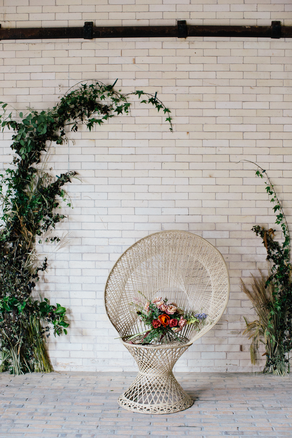 Ceremony flower arrangements by Nectar & Root | Wedding floral design services in Burlington, Vermont (VT) | Flower wall installation with ivy, grasses, eucalyptus