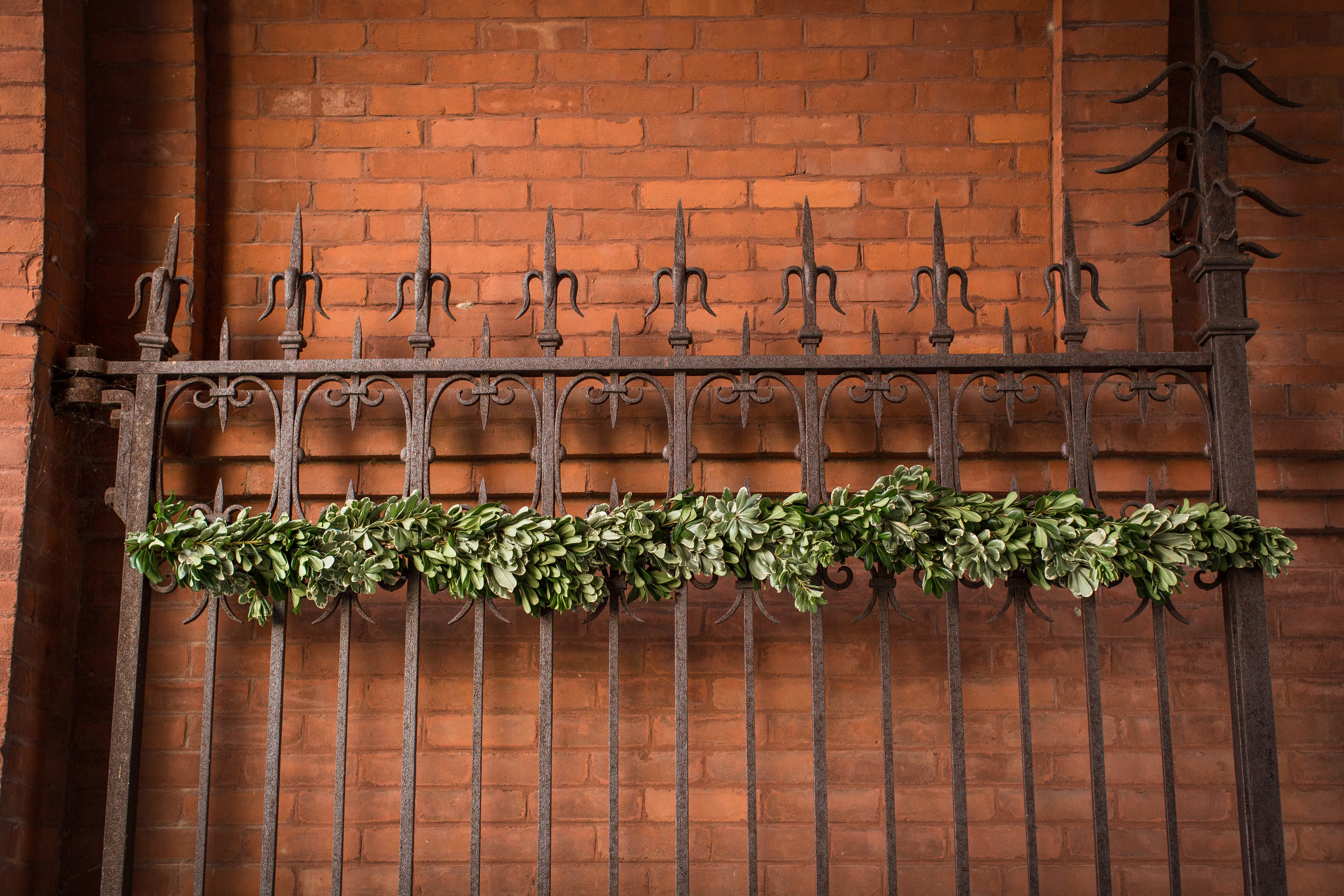 Wedding details and installations by Nectar & Root | Wedding floral design services in Burlington, Vermont (VT) | Garland of greenery on gate