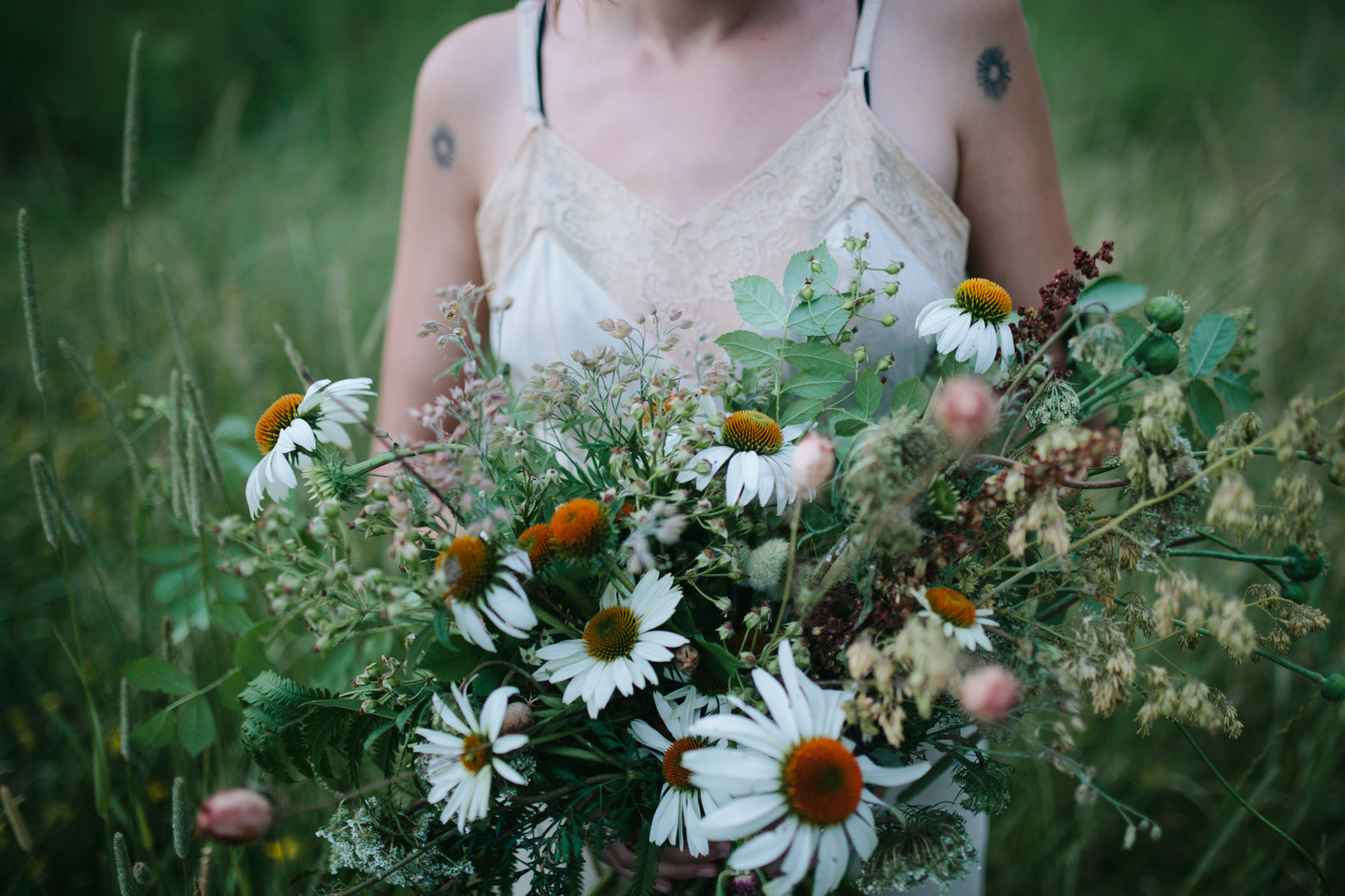 Summer wedding flowers by Nectar & Root | Wedding floral design services in Burlington, Vermont (VT) | Bridal bouquet of poppy pods, echinacea