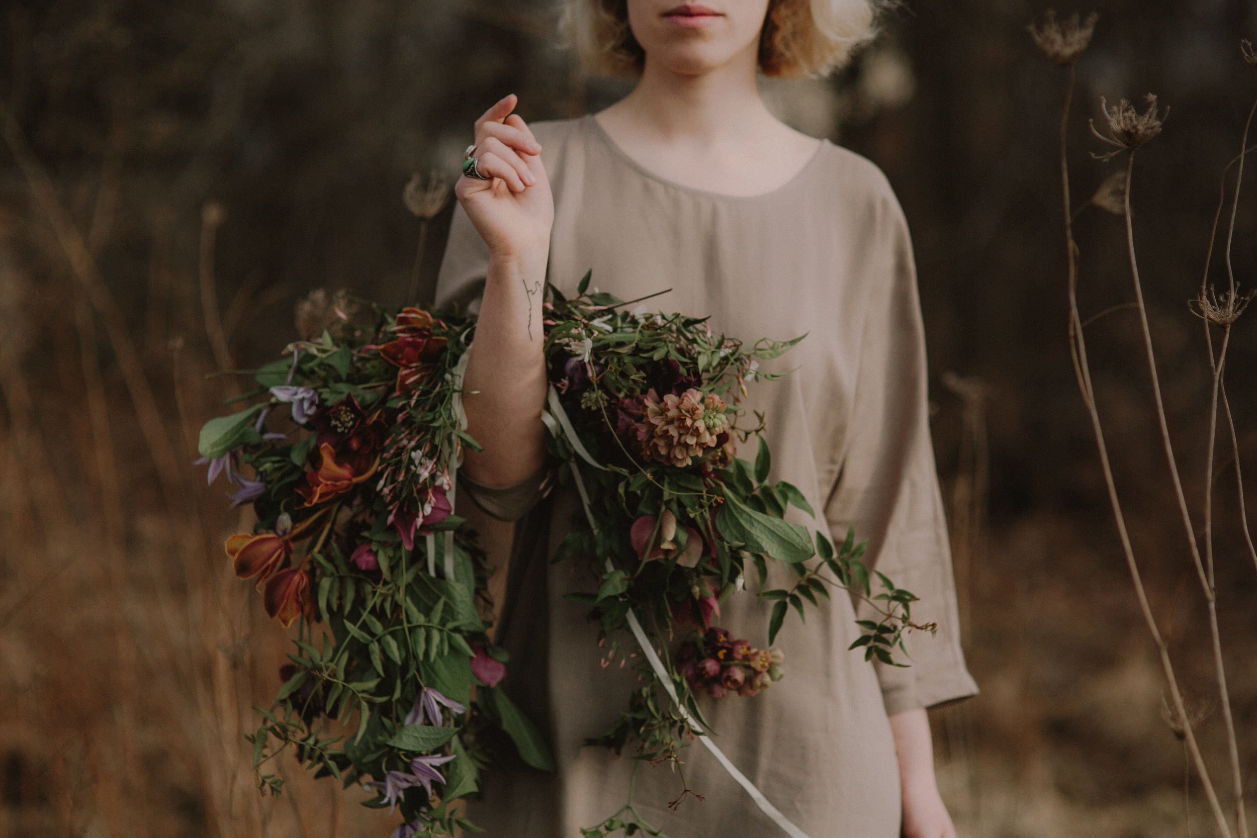 Fall wedding flowers by Nectar & Root | Wedding floral design services in Burlington, Vermont (VT) | Garland bouquet of fritillaria, orchids, clematis