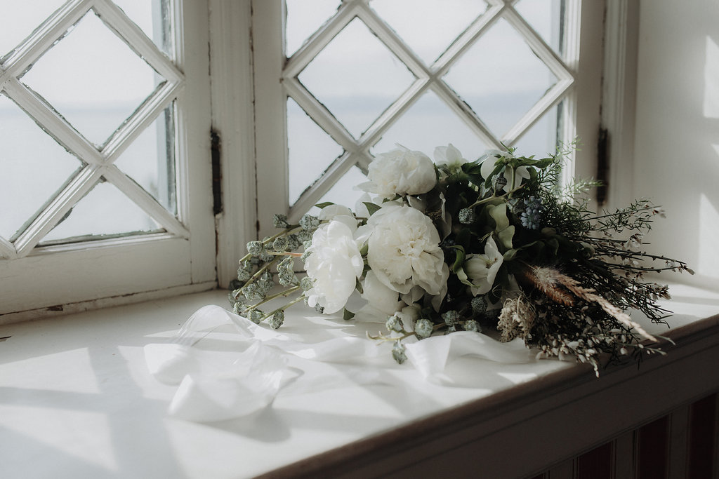 Winter wedding flowers by Nectar & Root | Wedding floral design services in Burlington, Vermont (VT) | Green, white and blue bouquet with peonies, dried grasses