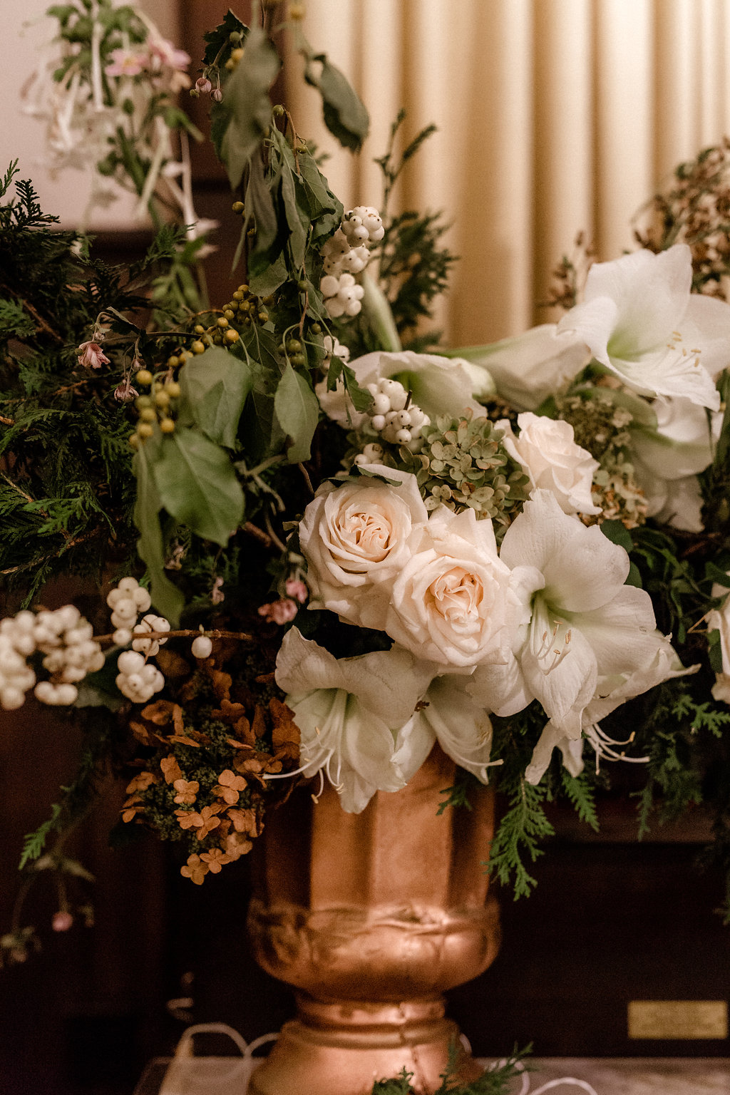 Winter wedding flowers by Nectar & Root | Wedding floral design services in Burlington, Vermont (VT) | Centerpiece with snowberry, amaryllis, garden roses, snowberries, evergreens, nicotiana