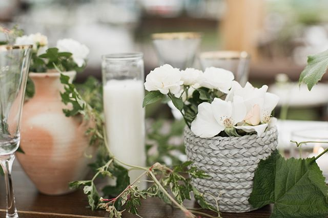 A favorite layering of vessels, candles and flowers from this past season