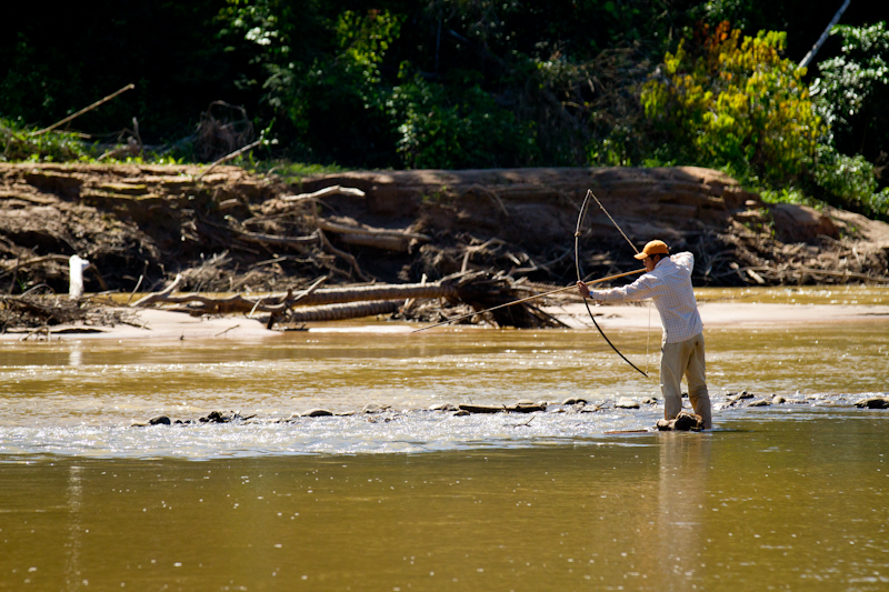 Native boatman hunting Sabalo during lunch break