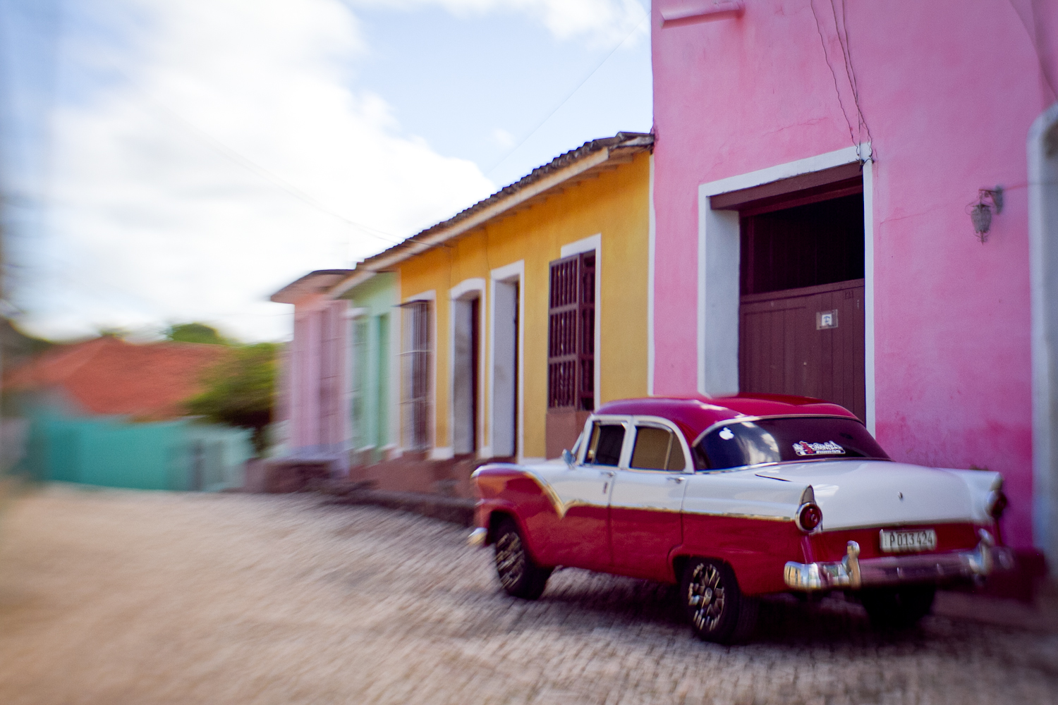 Old car, colorful houses, Trinidad, Cuba