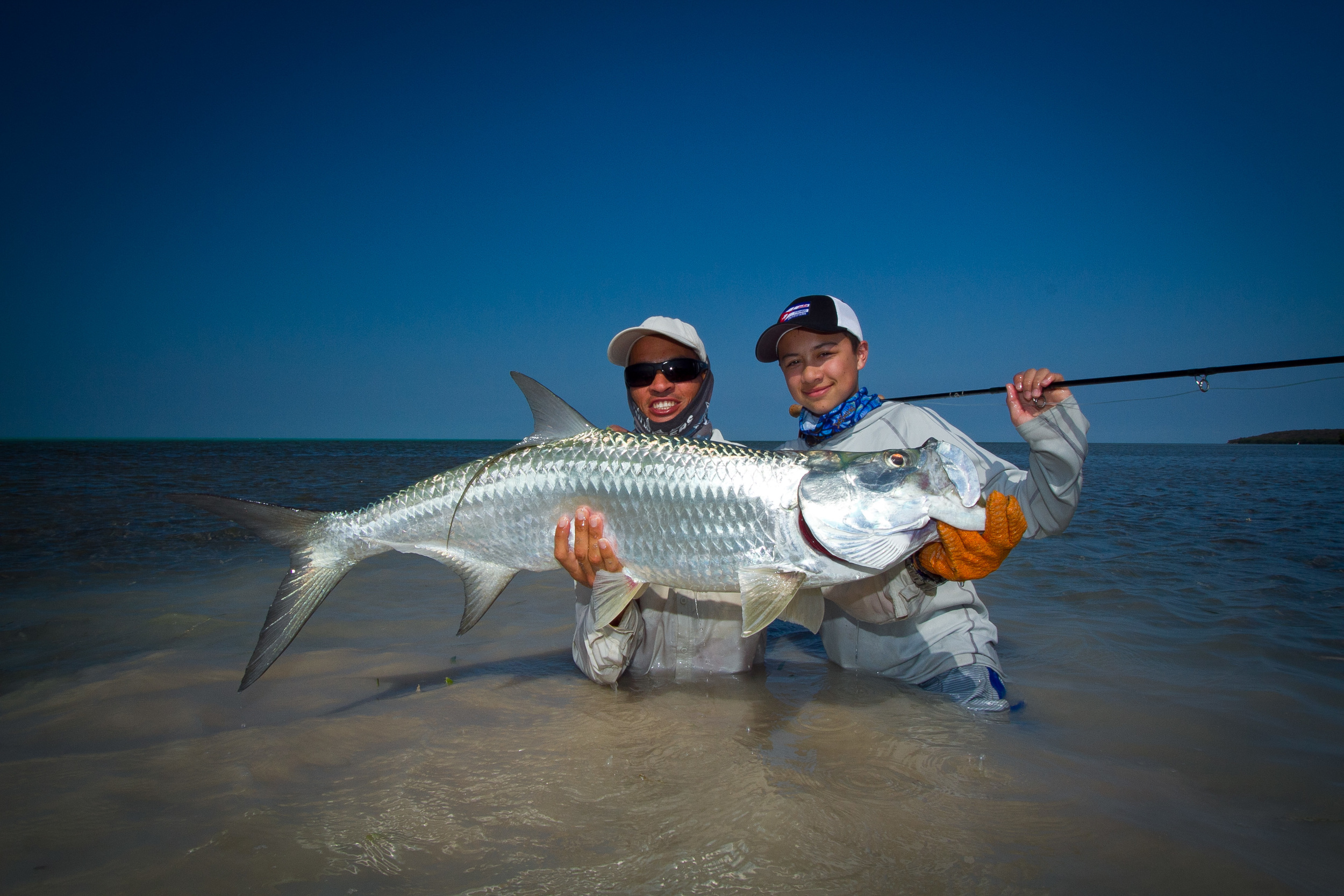 Yoandre and Teddy proudly showing off a landed Tarpon, Cayo Cruz, Cuba