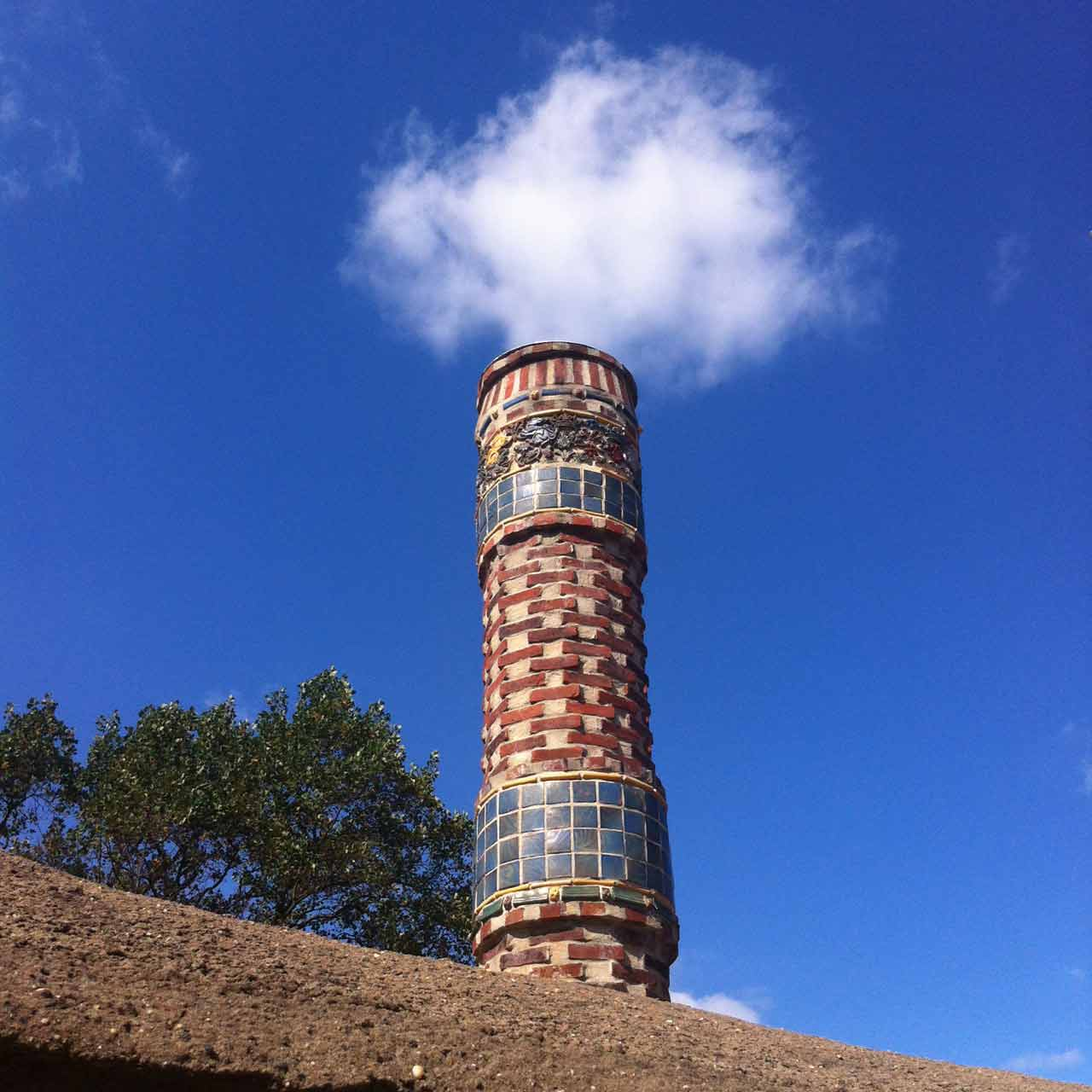 Detail of one of the chimneys featuring original tile work.