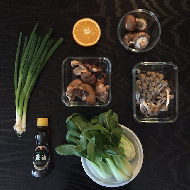 Miso paste and mirin can be found in the Asian foods section of Whole Foods, or other supermarkets. You'll need to stop by a liquor store for the sake.