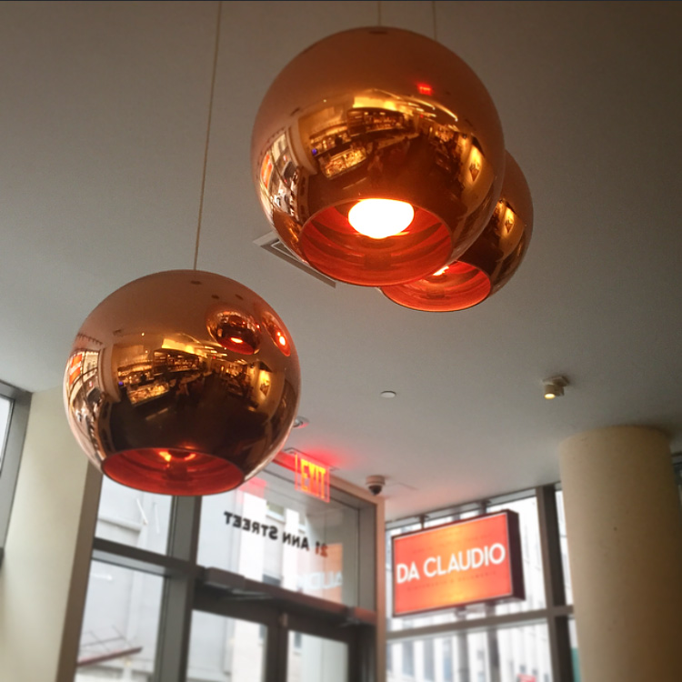 Brass light fixtures throughout the space are warm and inviting.