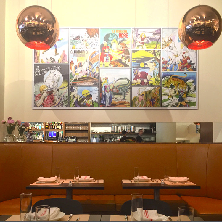 To bring some color to the space, the walls are decorated with vintage Italian comics from the 60's.