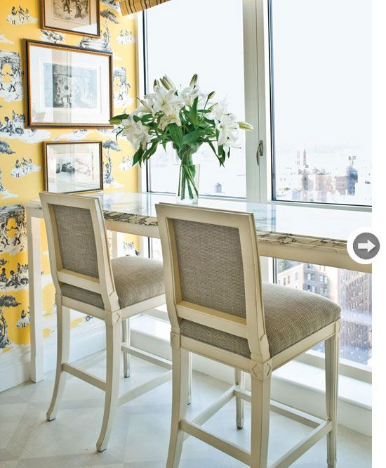 The Harlem Toile in yellow makes a sunny accent wall in this sleek and sophisticated home. Image via  Style at Home