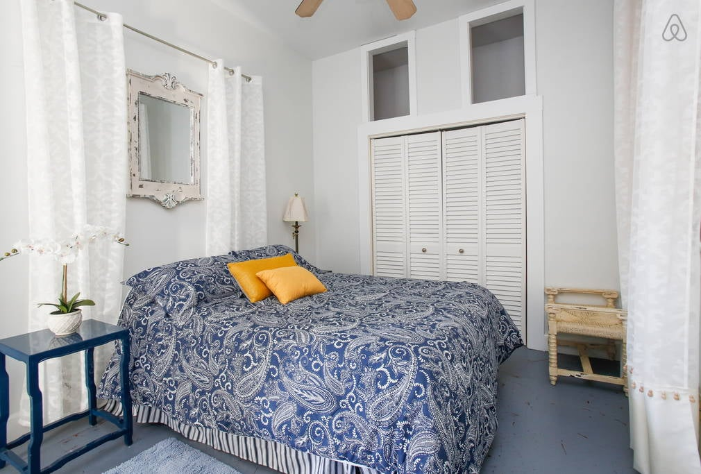 My favorite of the two bedrooms is bright and colorful with a generous size closet.  Image via   Airbnb
