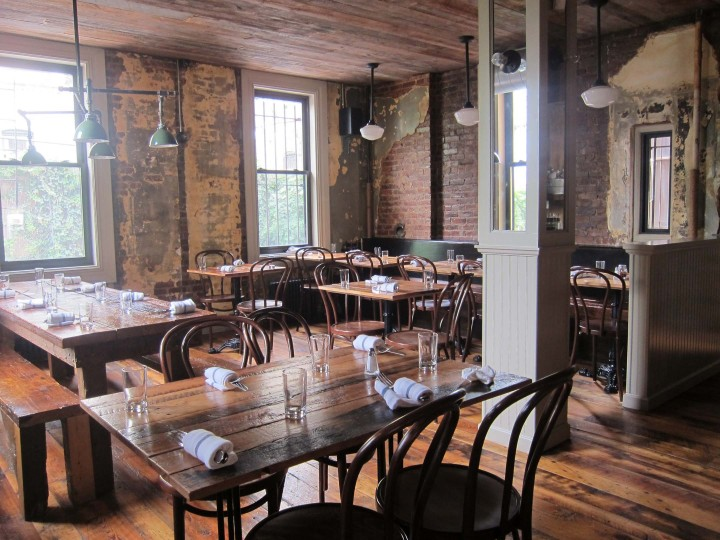 The rustic wood adds vintage character to this Brooklyn pizzeria. Image via  Sawkill Lumber Company .