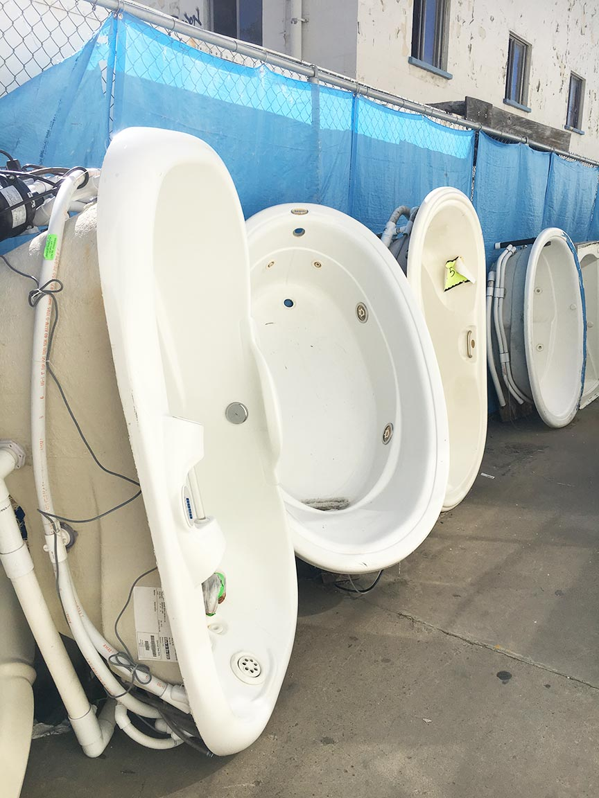 Bathtubs and whirlpools for sale.