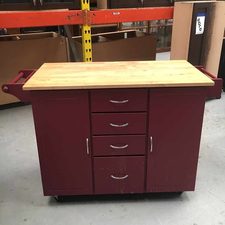 This rolling kitchen island could certainly come in handy. Personally, I would paint it blue!