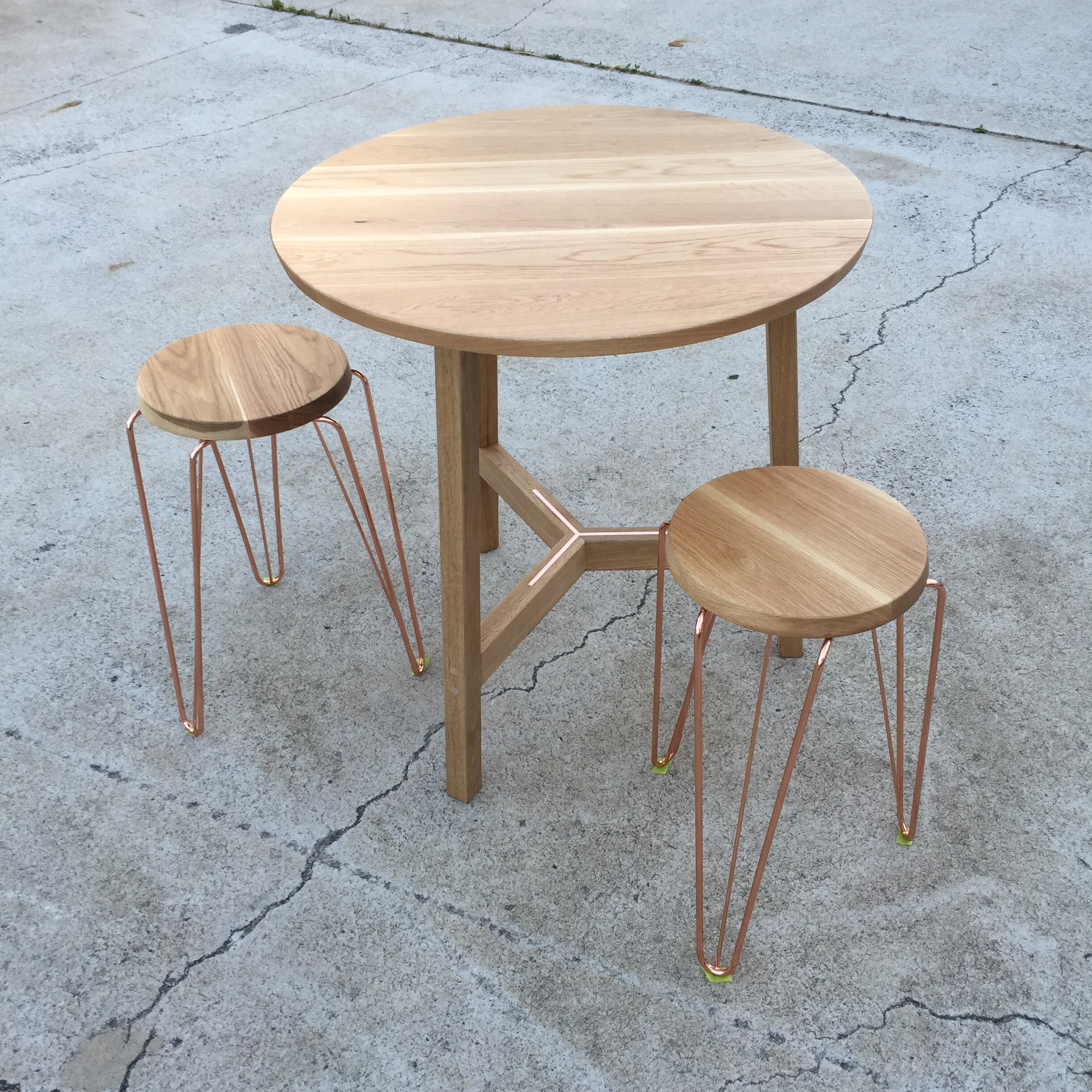 Tuckbox Design - Custom copper table and Rex stools for 2KW Bar