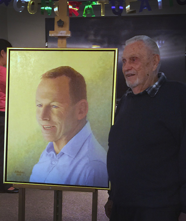 Phil Mulray with his Archibald painting of MP Tony Abbott.