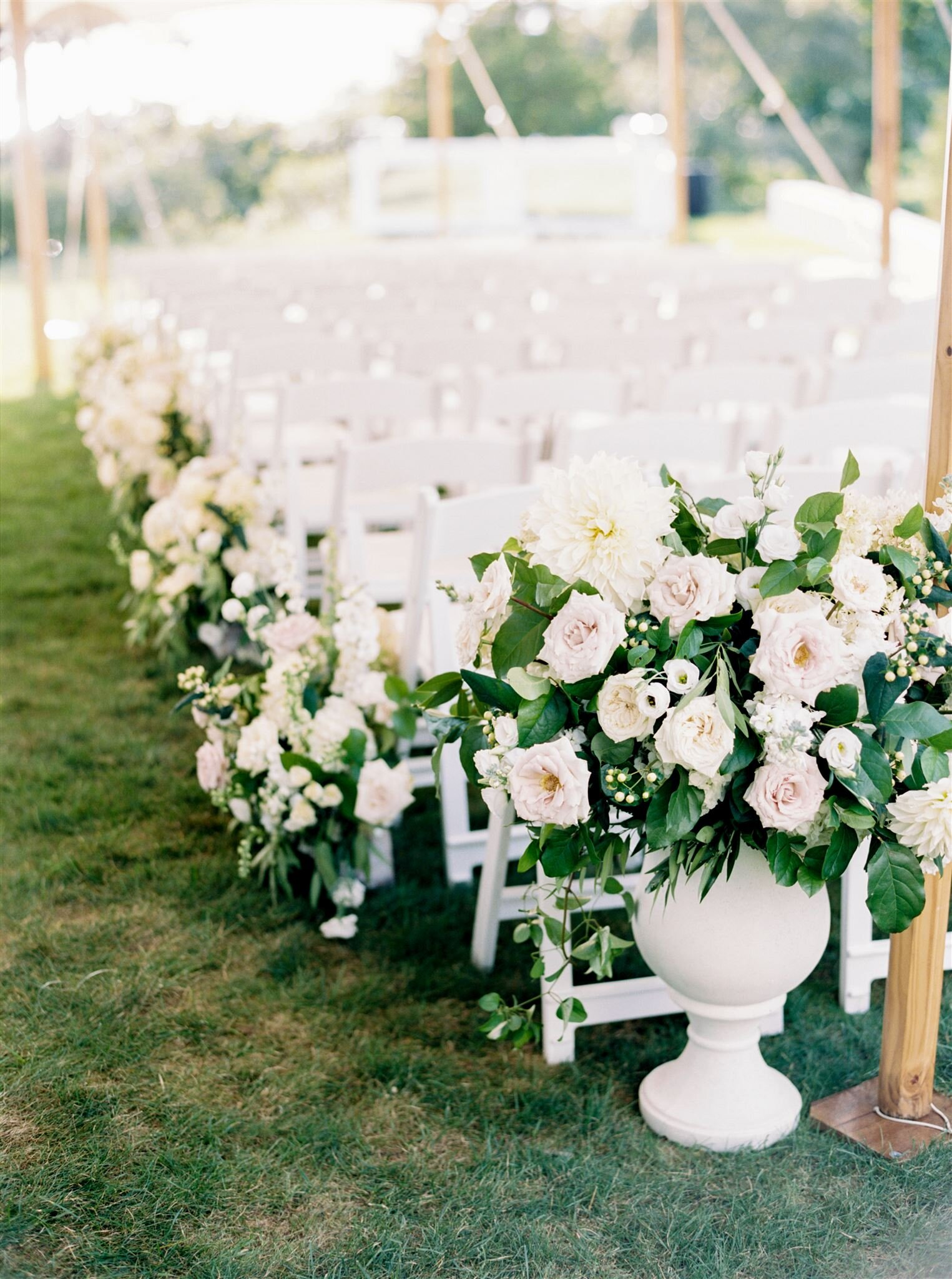 Ceremony aisle florals Floral by The Wild Dahlia | Photography by Elizabeth Laduca