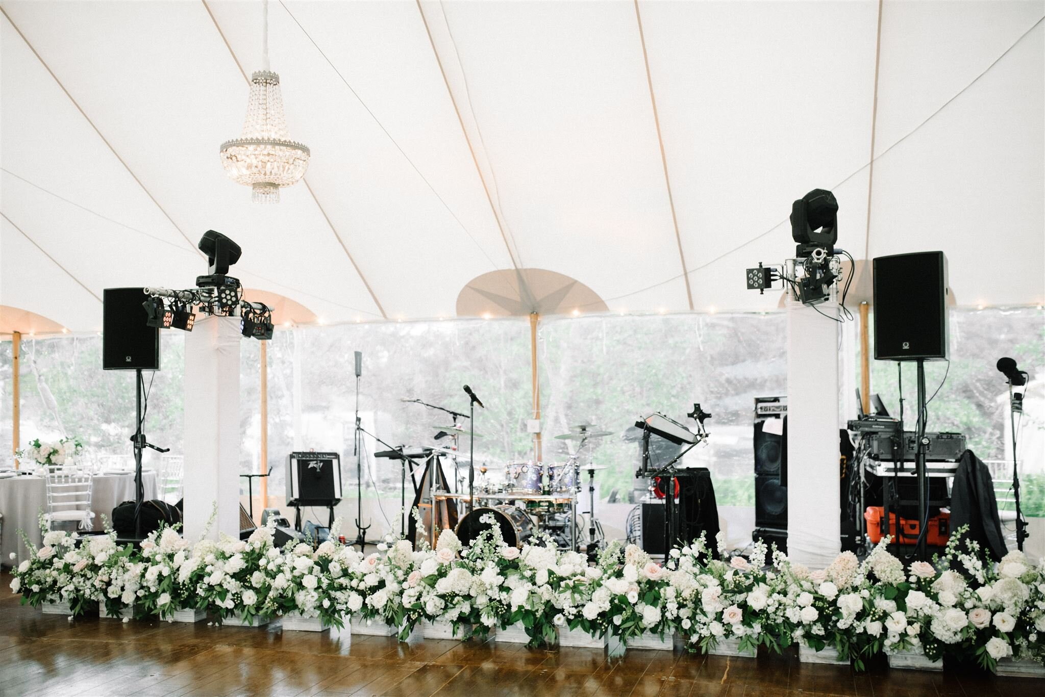 Ceremony aisle florals repurposed to the front of the stage Floral by The Wild Dahlia | Photography by Elizabeth Laduca