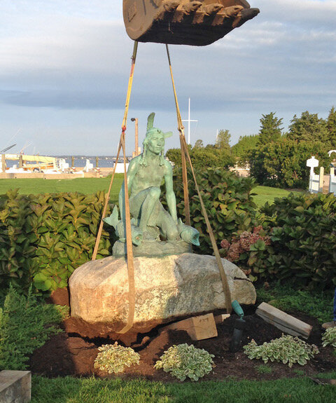 The Chief Ninigret hoist and Chief Ninigret's fish as fountains again with a small pond – restored!
