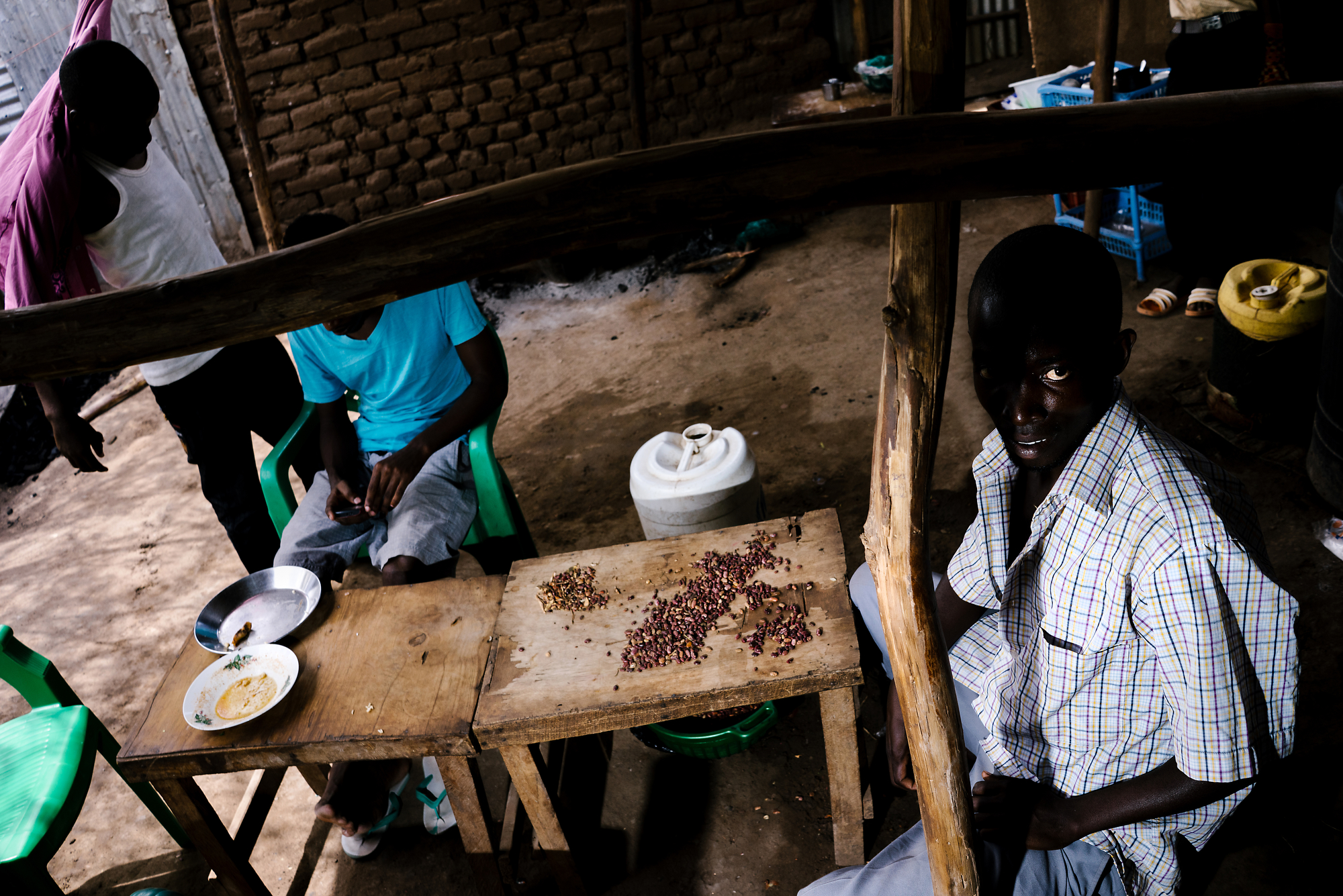 Men cook at a restaurant in Kakuma. The cafe is owned by a gay refugee from Uganda, and all of his employees are also gay Ugandans.