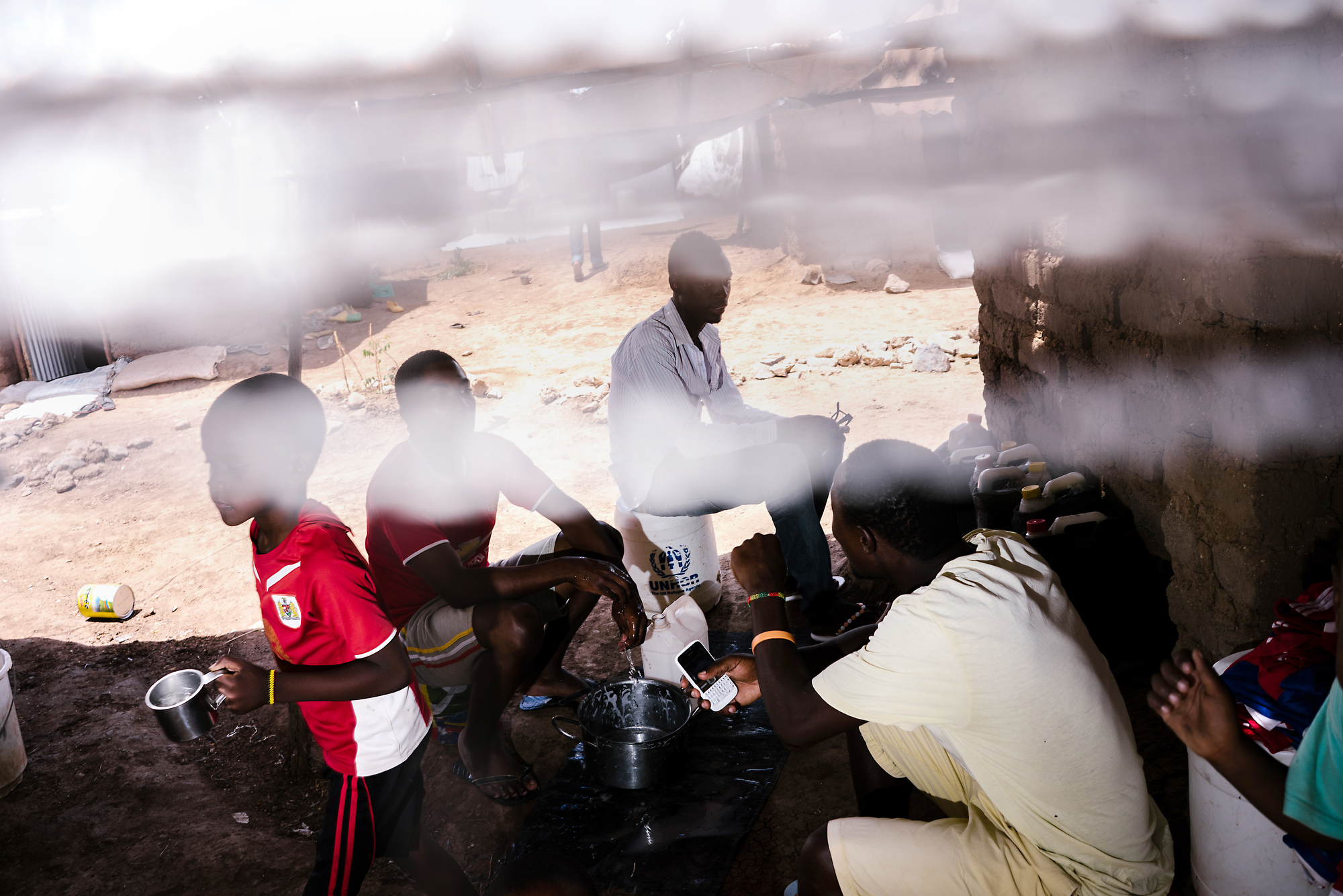 The Ugandans gather in one of the LGBT compounds. Much of the Kakuma refugee camp is unsafe for the LGBT refugees to walk around. The UN placed them in a special compound for their safety, but it means they spend most of their time cooped up in a small space.