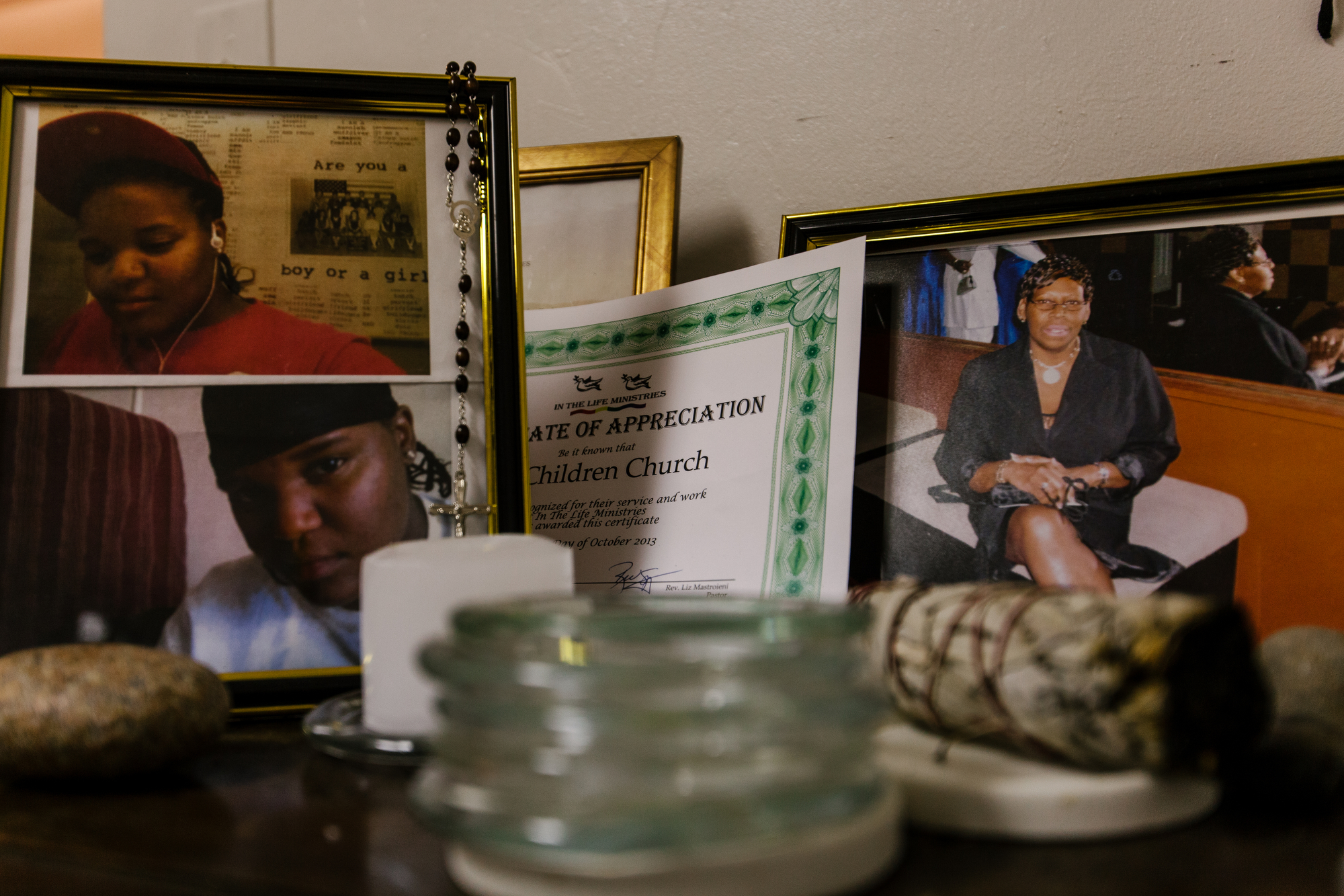 Members of the church often go through hard times due the intersectional hardship of their sexuality, their race, their class. Here, photos of past members of the church that committed suicide, serve as a mini-memorial in the church's office.