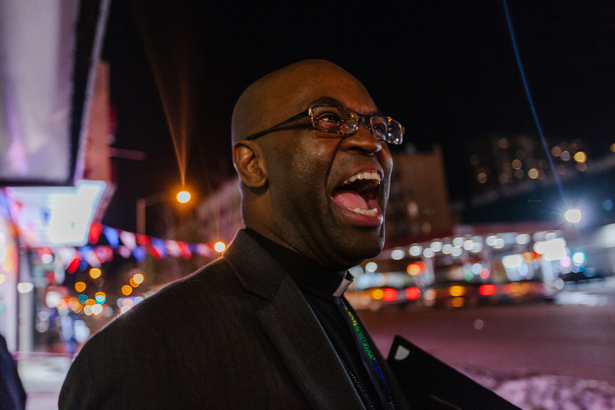 Rev. James laughs after receiving an award from Al Sharpton's National Action Network for Dusenbury's service to the LGBT community.